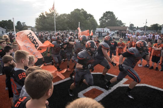 Waverly's high school football team runs onto the field before a game against Zane Trace in 2018. Waverly went 9-2 and finished second in the SOC II last year, now they look to go deeper in the playoffs in 2019.