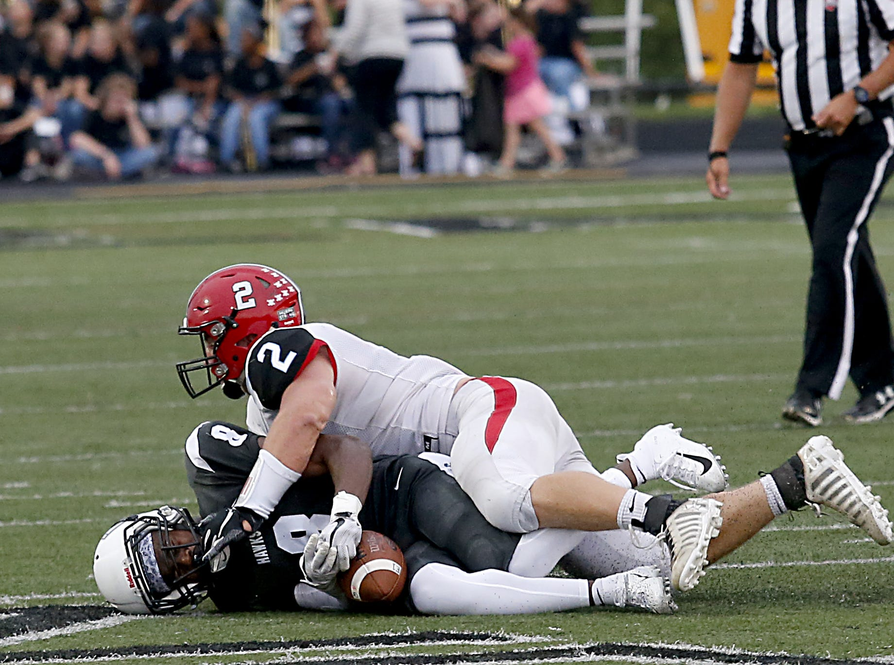 Lakota East running back Donnie Wilkinson is tackled by Kings linebacker Jake Stylski during their Skyline Chili Crosstown Showdown game at Lakota East Friday, August 31, 2018.