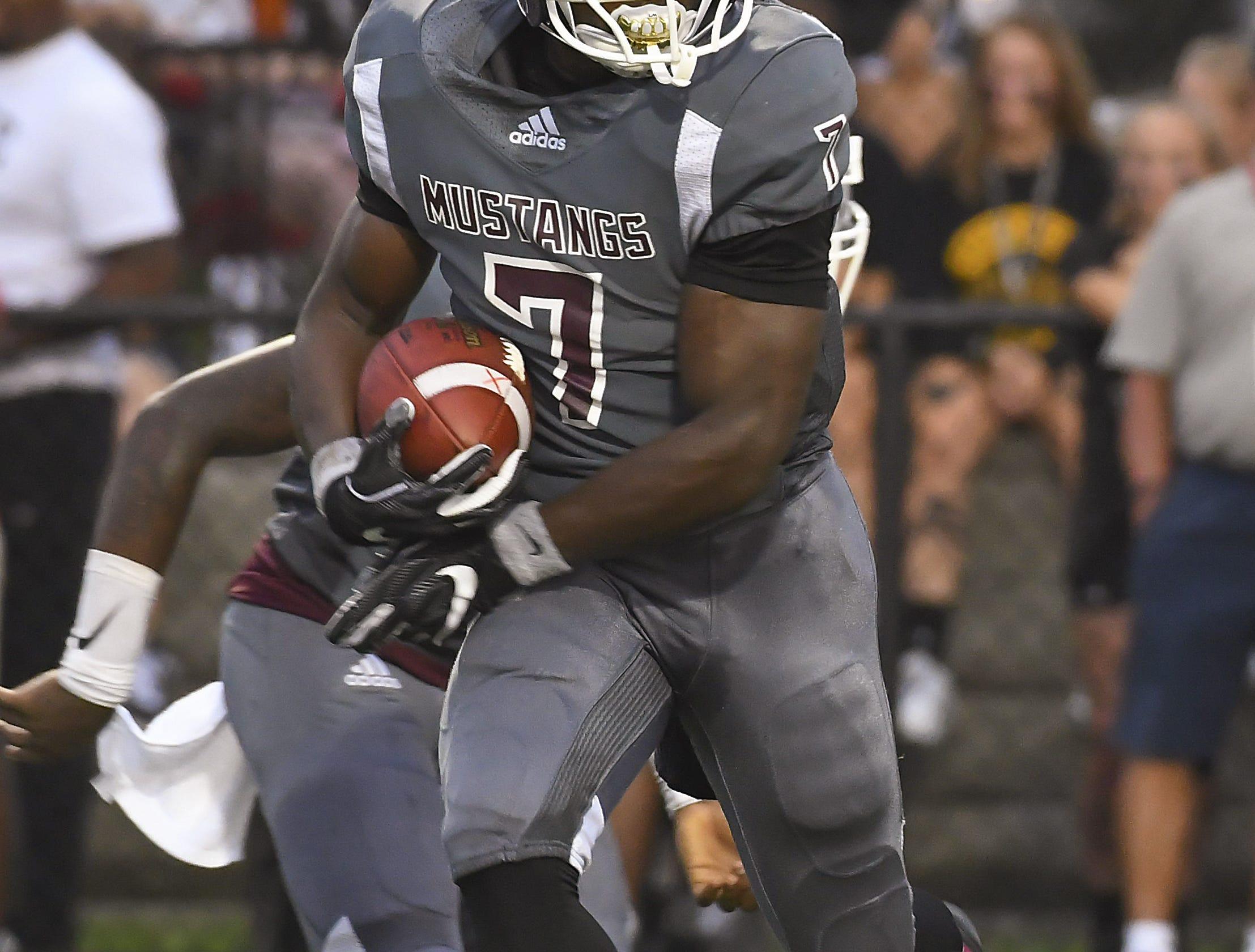 Mustangs running back Kayvon Britten runs the ball against  Roger Bacon, Western Hills High School, Aug. 31, 2018