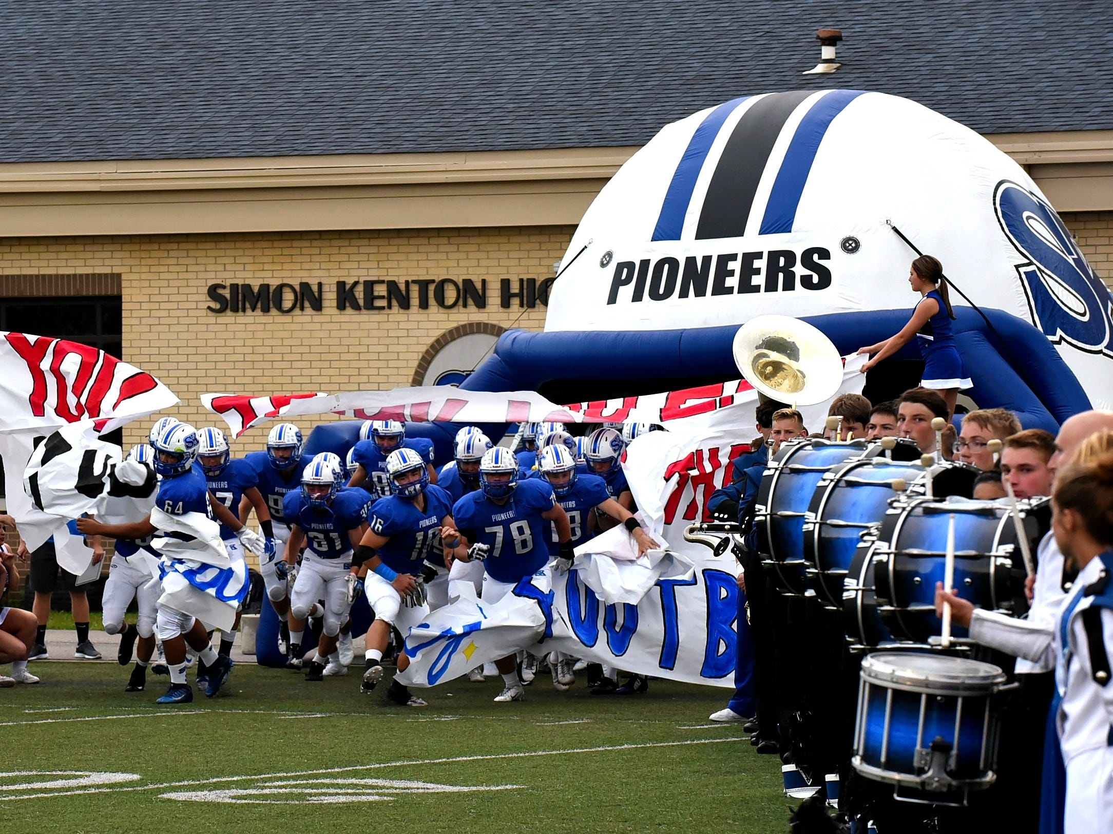 The Pioneers of Simon Kenton break the banner and take the field for their home game against Conner, August 31, 2018.