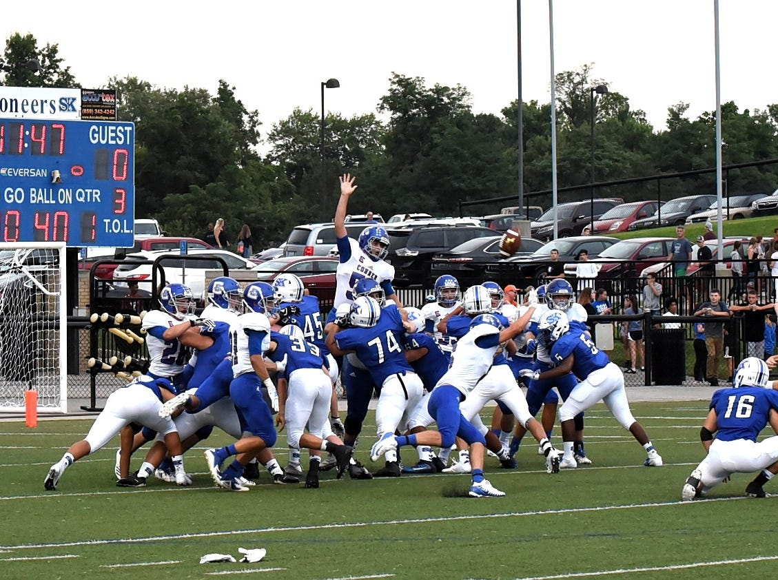 Simon Kenton kicker Christian Seger lifts the PAT to the goal post after the game opening kickoff return for touchdown by the Pioneers, August 31, 2018.