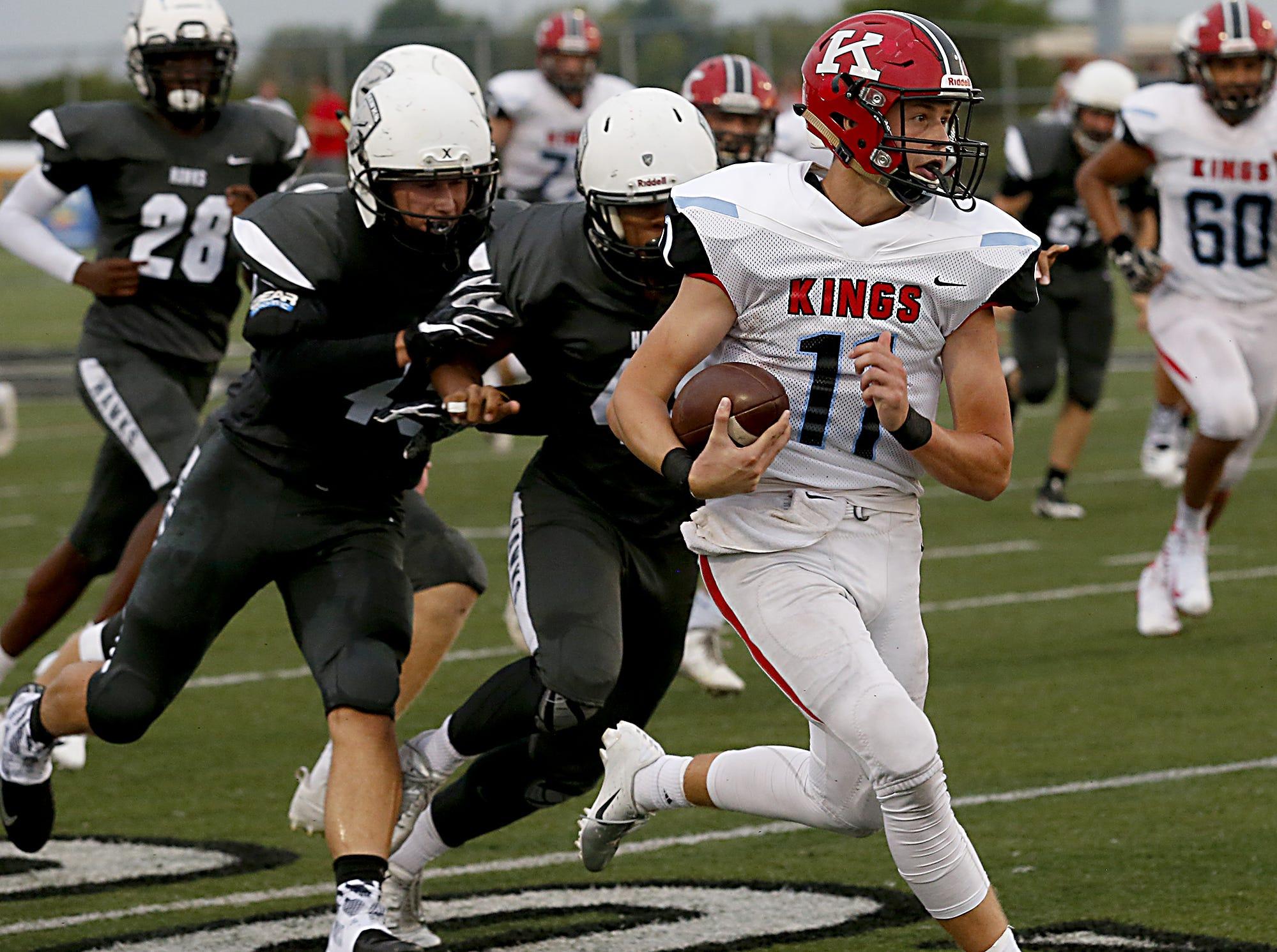 Kings quarterback Ashton Koller runs for yardage against Lakota East during their Skyline Chili Crosstown Showdown game at Lakota East Friday, August 31, 2018.