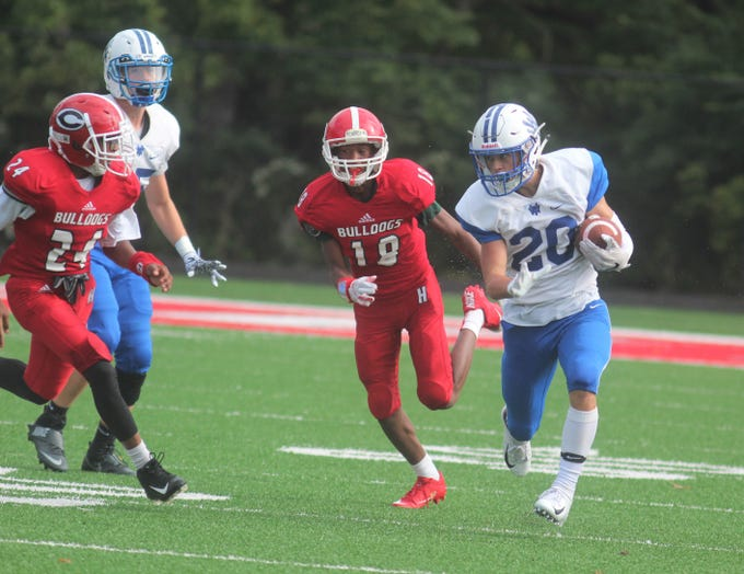 Walton-Verona junior Peyton Smith runs upfield against Holmes during Walton-Verona's 48-0 win over Holmes September 1, 2018 at Holmes High School, Covington KY. The game concluded on Saturday morning after being suspended at halftime because of weather.