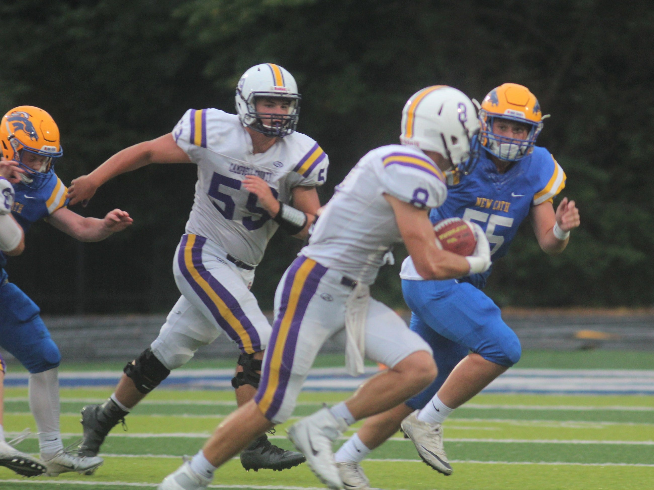 Grant Jolly of Campbell County looks for running room with NCC junior Daniel Craig in pursuit as Campbell County and Newport Central Catholic played a football game August 31, 2018 at Covington Catholic High School. Campbell County led 24-0 at halftime when the game was suspended due to lightning.