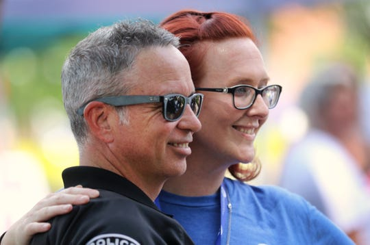 Newtown Police Chief Tom Synan, with the Hamilton County Heroin Coalition, and Amy Parker, peer counselor who's been in recovery from opioid use disorder for seven years, stand together at an Overdose Awareness Day in Washington Park in 2018.