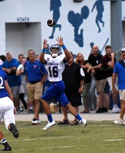 Emmanuel Merkel (16) of Conner looks in a touchdown pass for the Cougars, August 31, 2018.