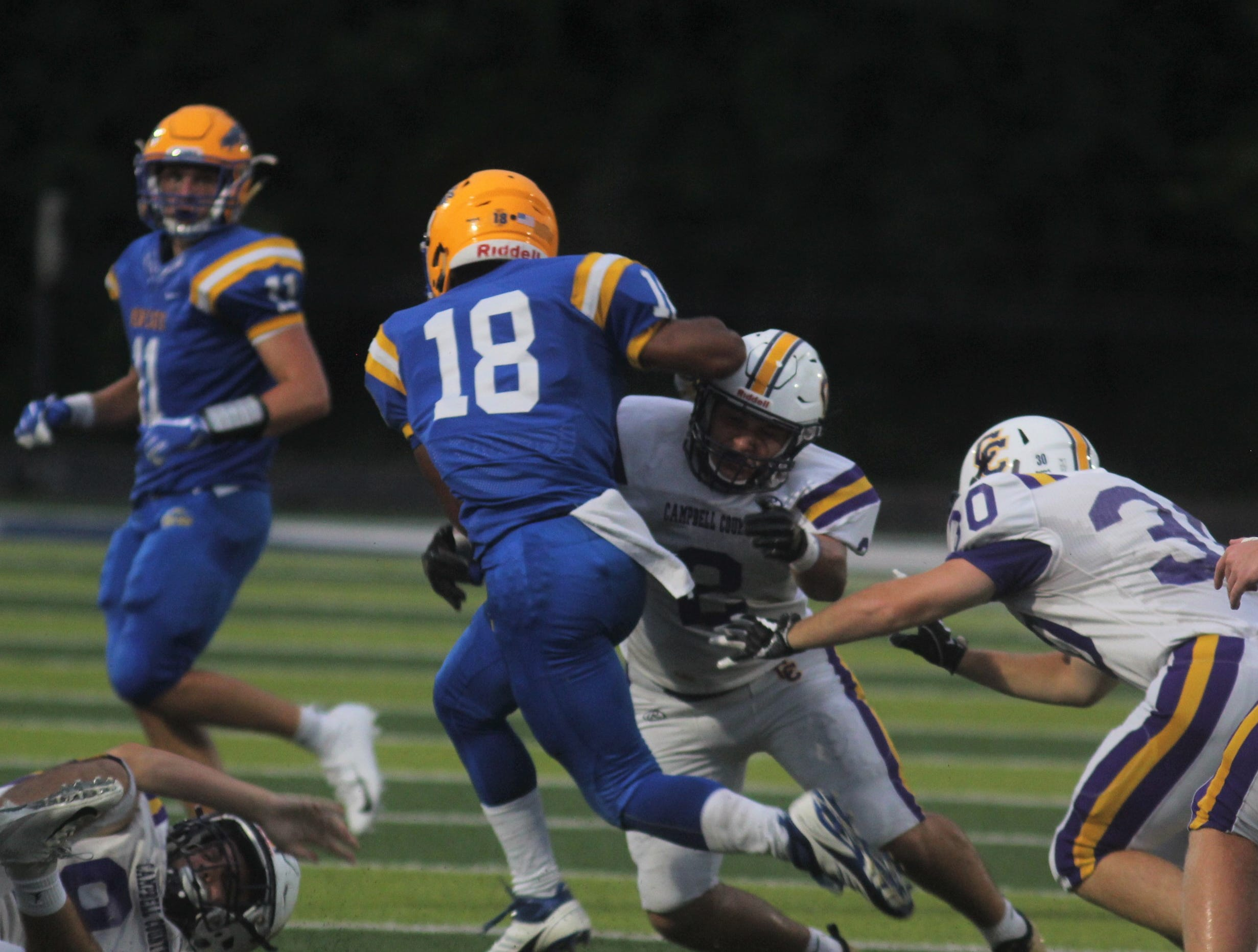 Campbell County senior Logan Harrod tackles NCC's Hezekiah Miller as Campbell County and Newport Central Catholic played a football game August 31, 2018 at Covington Catholic High School. Campbell County led 24-0 at halftime when the game was suspended due to lightning.