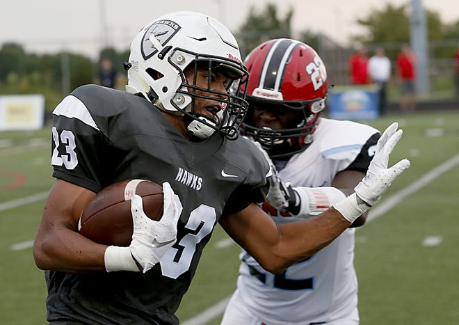 Lakota East ball carrier Avi McGary breaks the tackle of Kings would-be tackler Devin Squires during their Skyline Chili Crosstown Showdown game at Lakota East on Friday.