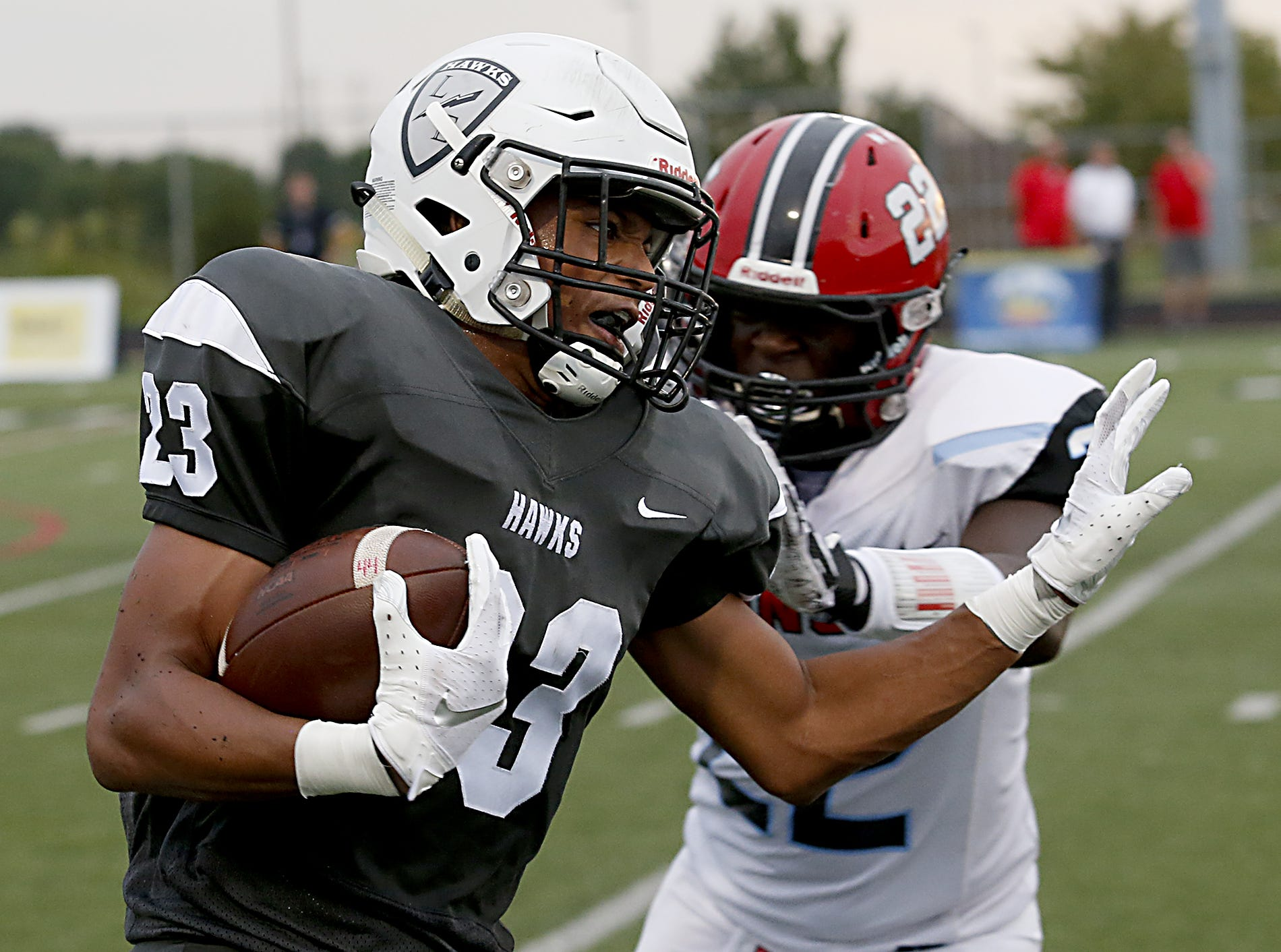 Lakota East ball carrier Avi McGary breaks the tackle of Kings would-be tackler Devin Squires during their Skyline Chili Crosstown Showdown game at Lakota East Friday, August 31, 2018.