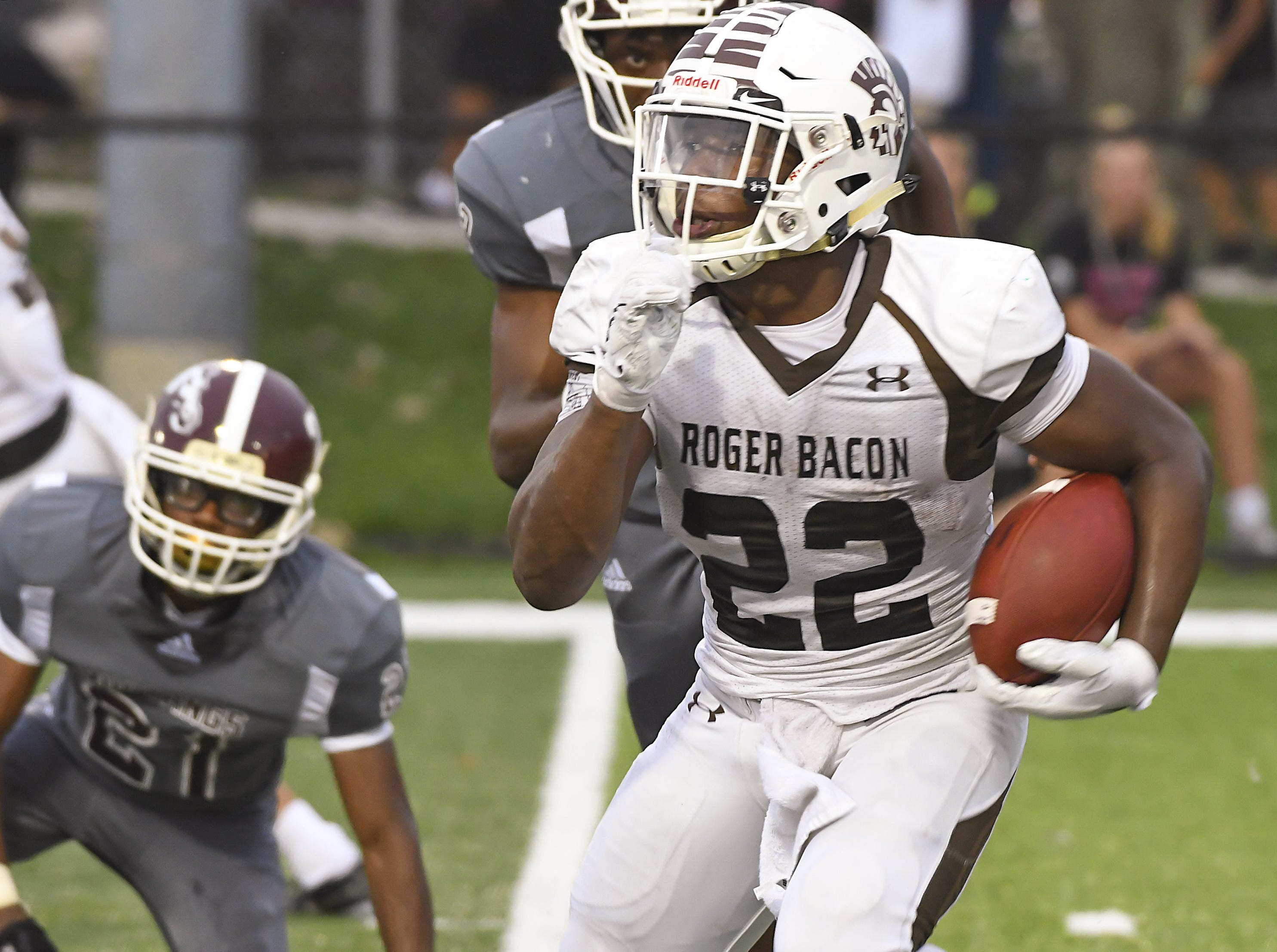 Roger Bacon running back Corey Kiner (22) runs the ball against Western Hills, Western Hills High School, Aug. 31, 2018