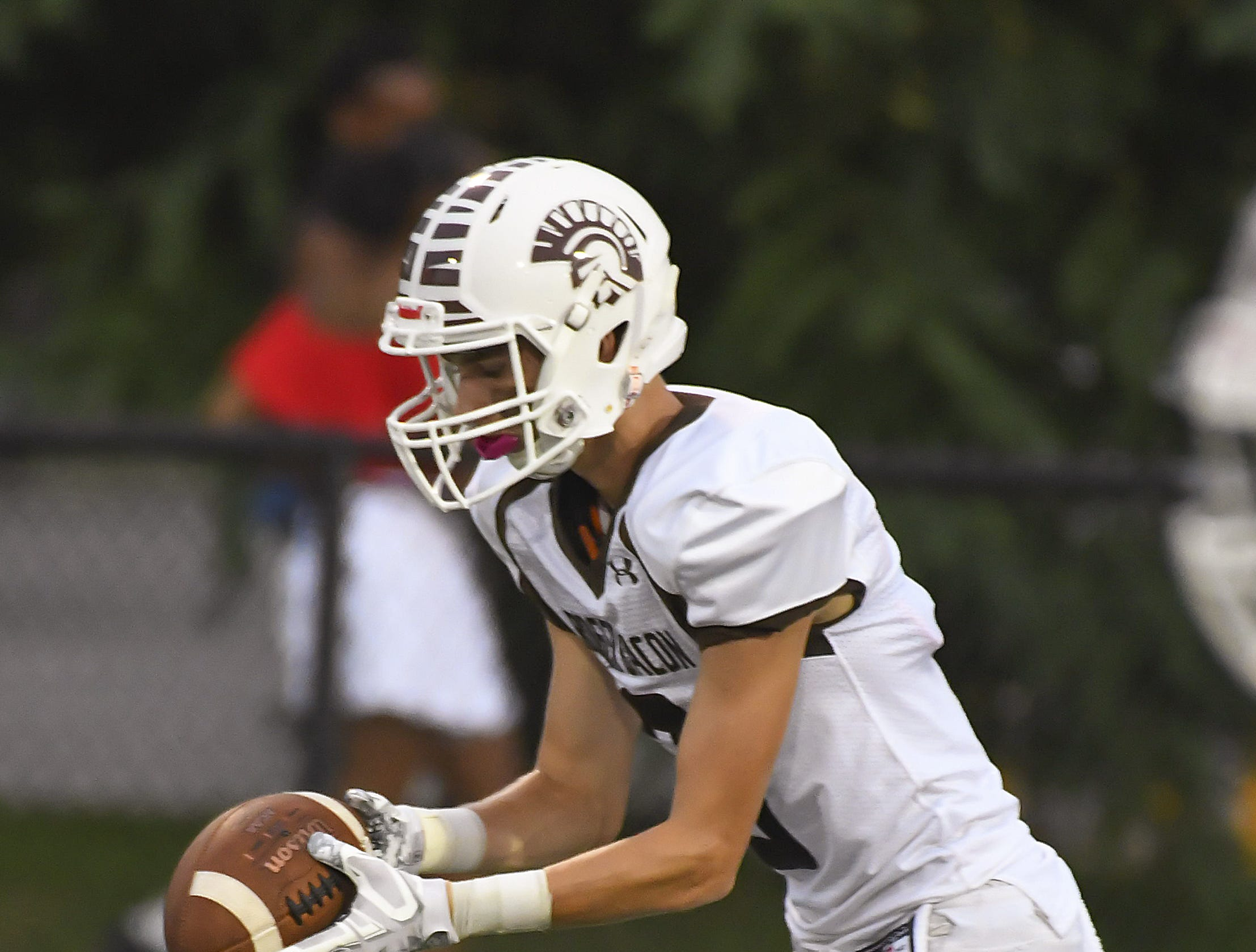 Roger Bacon's Luke Byrd punts the ball to the Mustangs, Western Hills High School, Aug. 31, 2018