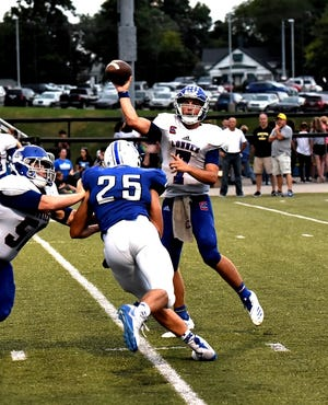 Conner quarterback Jared Hicks drops off a pass over the oncoming Simon Kenton defensive rush, August 31, 2018