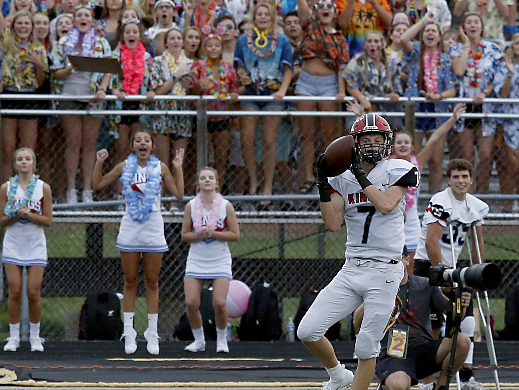 Kings wide receiver Jack McHugh brings down a pass and runs for a touchdown  during their Skyline Chili Crosstown Showdown game at Lakota East Friday, August 31, 2018.