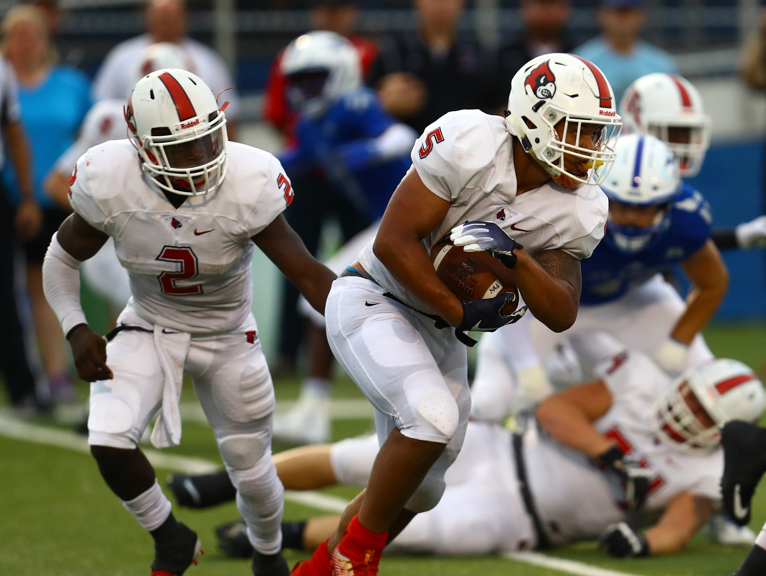 Colerain running back Ivan Pace Jr. runs the ball in the game between the Colerain Cardinals and the Saint Xavier Bombers at Saint Xavier High School Aug. 31.
