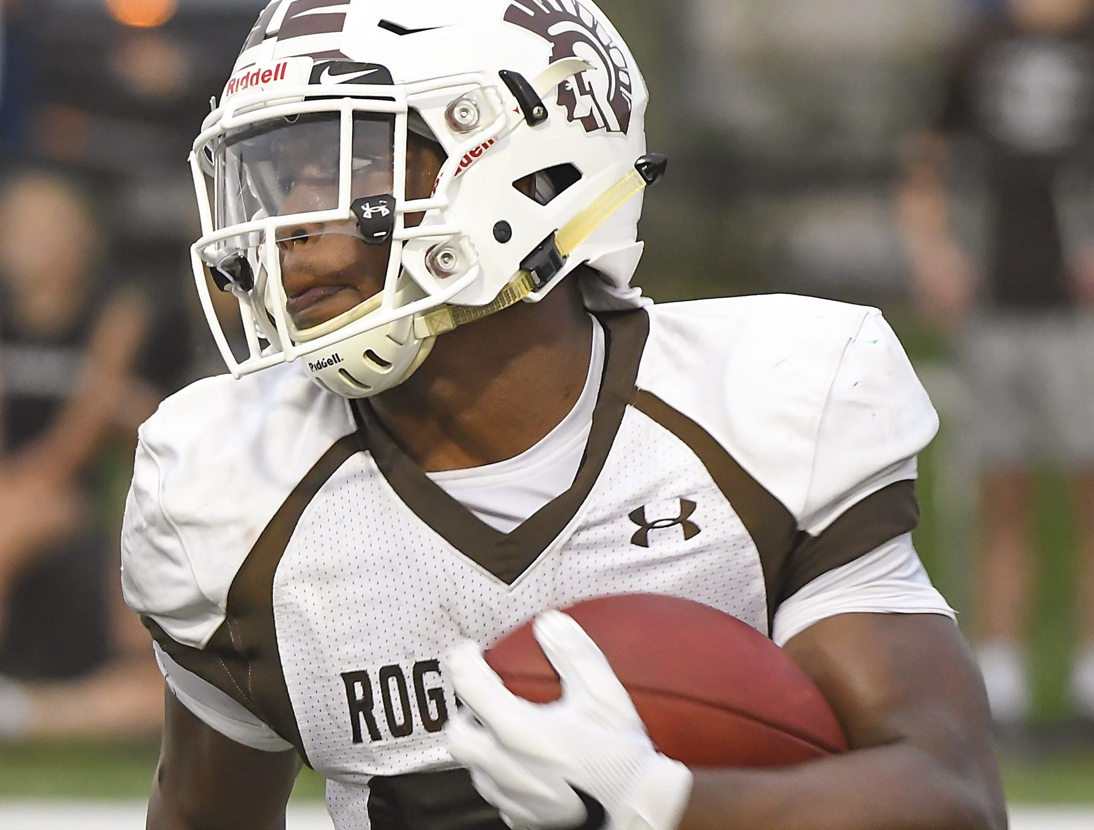 Roger Bacon running back Corey Kiner runs the ball against Western Hills, Western Hills High School, Aug. 31, 2018