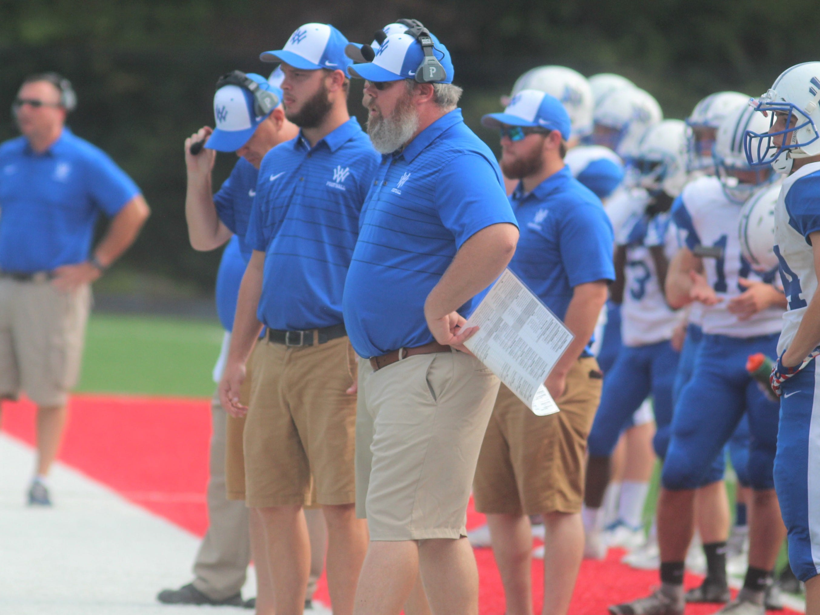 Walton-Verona head coach Jeff Barth, foreground, watches his team during Walton-Verona's 48-0 win over Holmes September 1, 2018 at Holmes High School, Covington KY. The game concluded on Saturday morning after being suspended at halftime because of weather.
