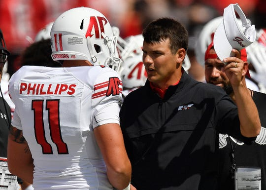 Austin Peay head coach Will Healy speaks to Austin Peay wide receiver DeAngelo Wilson (11) during the first half of an NCAA college football game, Saturday, Sept. 1, 2018, in Athens, Ga.