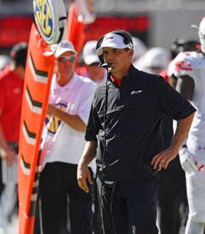 Austin Peay head coach Will Healy watches Georgia kick an xtra point during the first half of an NCAA college football game, Saturday, Sept. 1, 2018, in Athens, Ga.