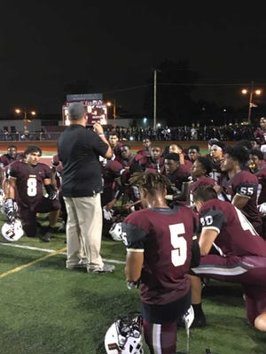 Union coach Lou Grasso addresses his team following a 14-7 win over Linden on Aug. 31.