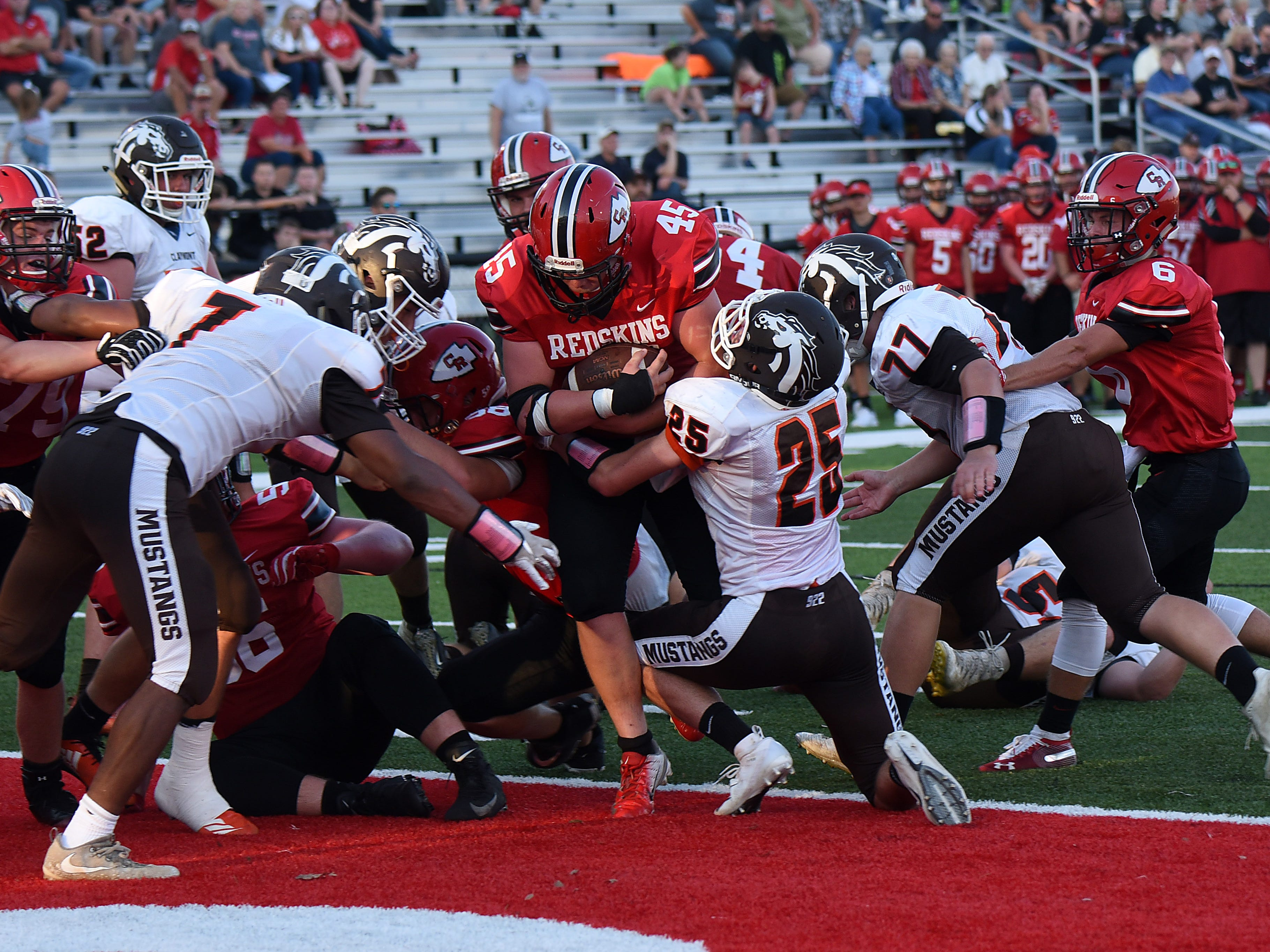 Coshocton senior Zach Crown breaks through the scrum and in to the end zone during Friday night's home opener. Coshocton won 42-6.