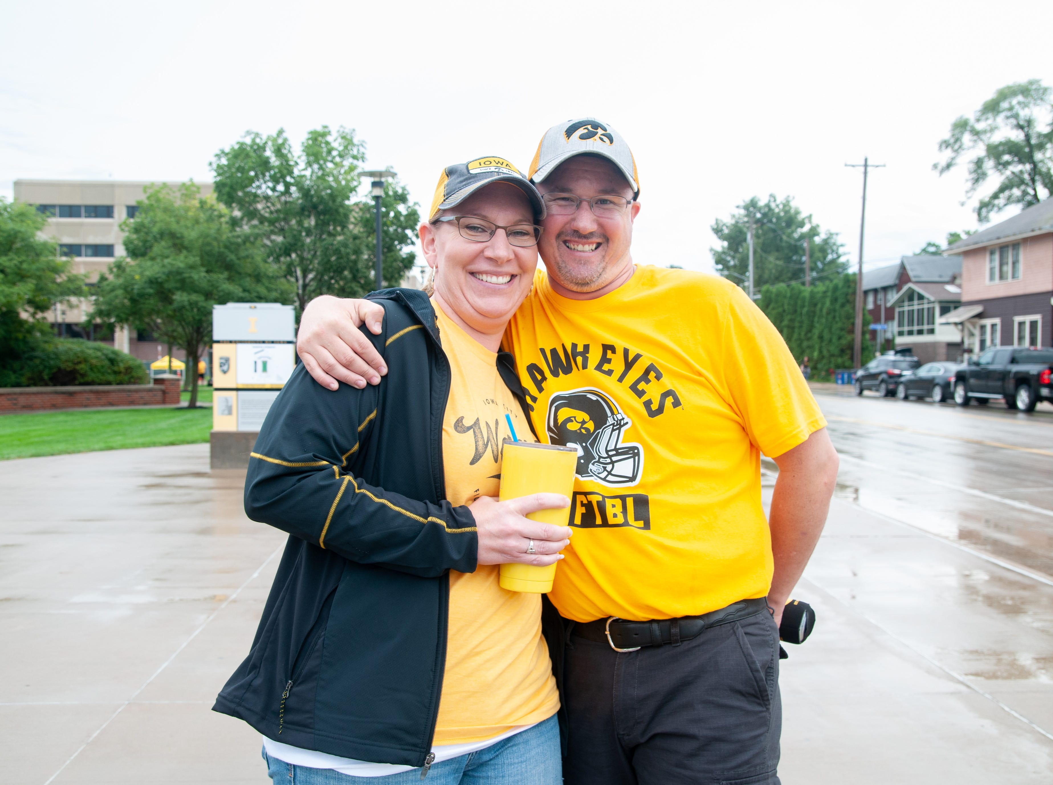 Alyssa Linnenbrink, 40, (left), and John Lehman, 38, of the Quad Cities, Saturday, Sept. 1, 2018, while tailgating before the Iowa game against Northern Illinois in Iowa City.