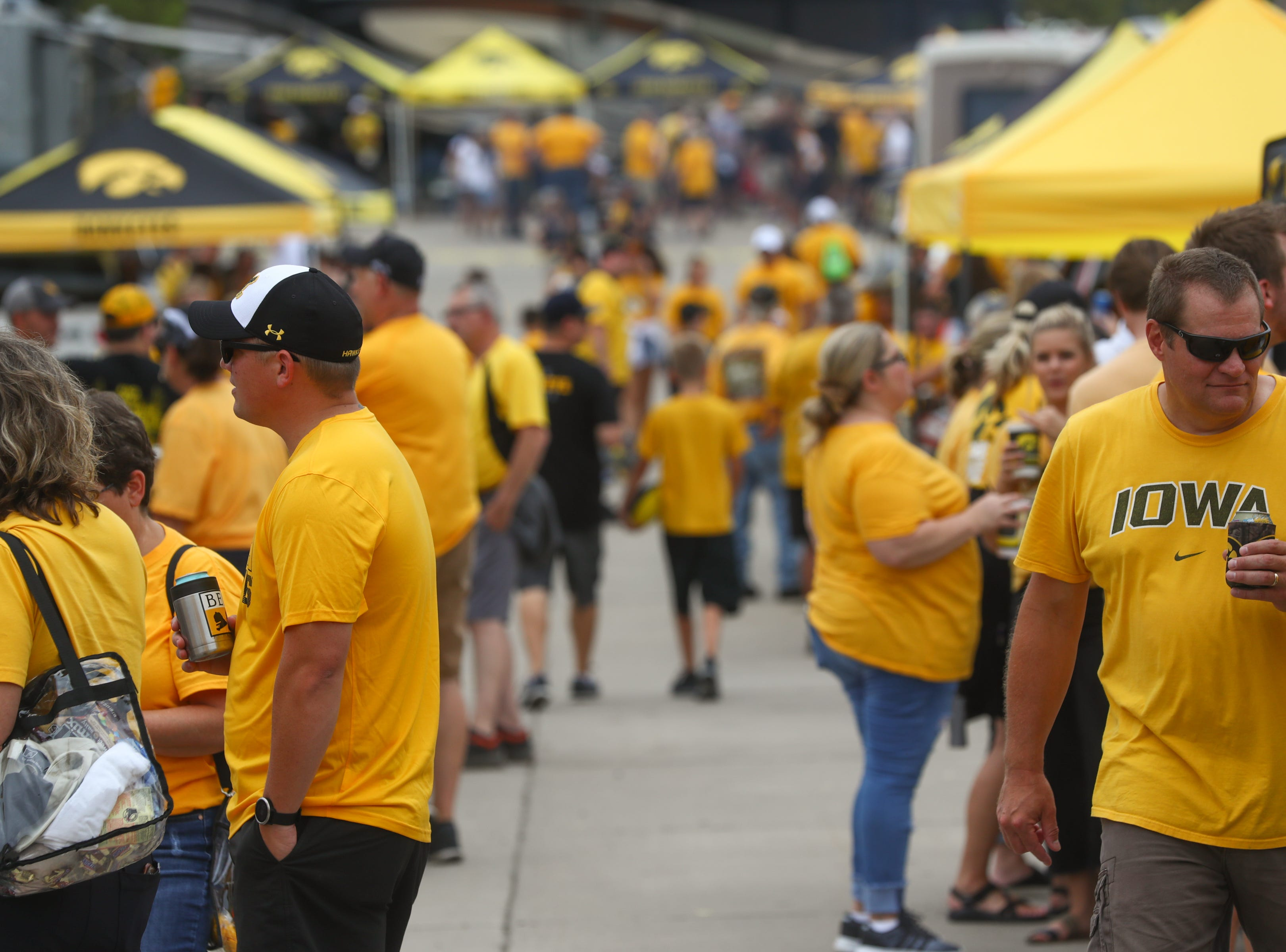 Iowa fans tailgate outside Kinnick Stadium before the Hawkeyes' game against Northern Illinois on Satuday, Sept. 1, 2018.