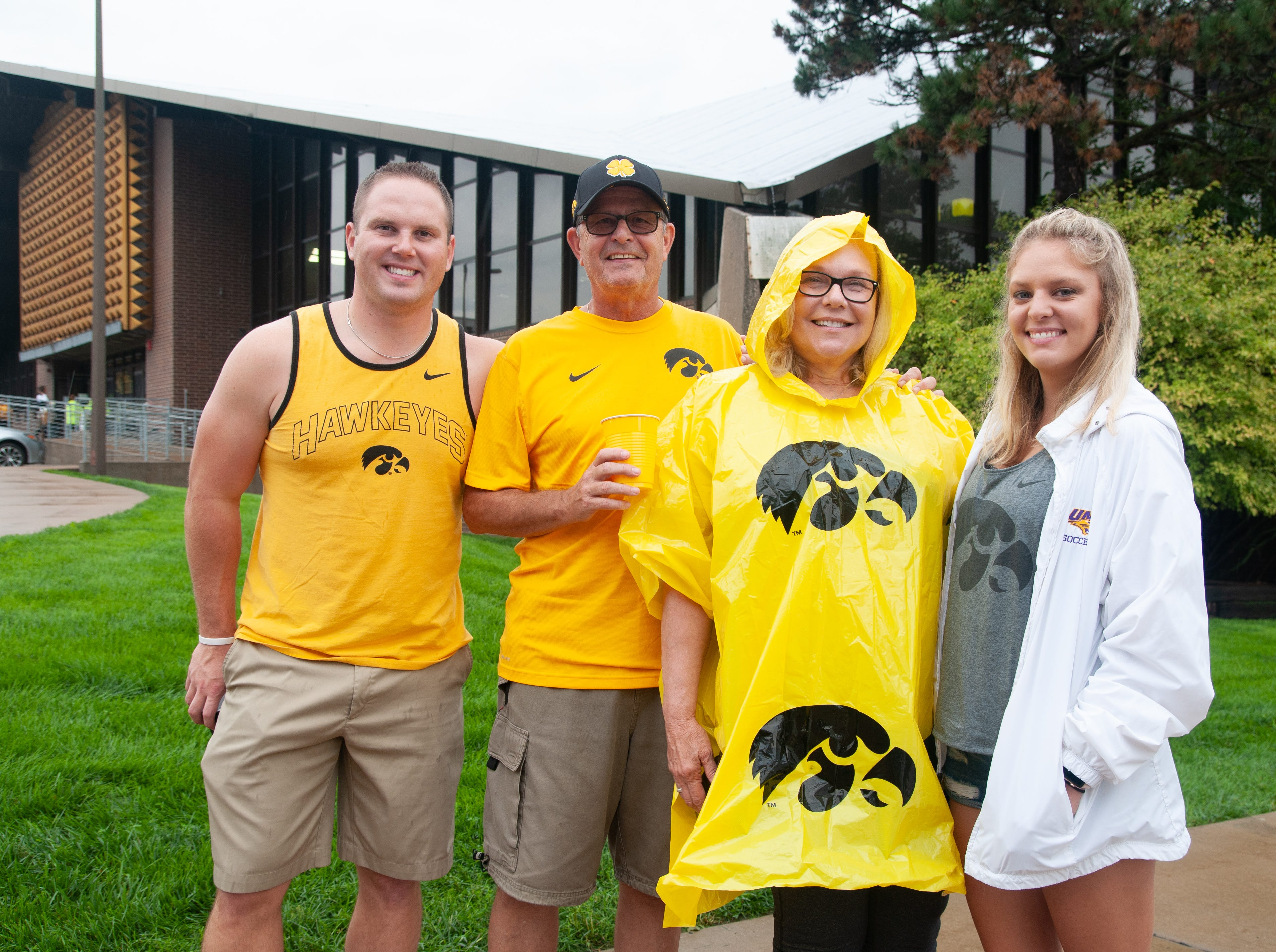 Zach Parsons, 26, (left), Craig Schulte, 65, Martha Parsons, 65, and Liz Parsons, 25, of Cedar Rapids and Mount Vernon, Saturday, Sept. 1, 2018, while tailgating before the Iowa game against Northern Illinois in Iowa City.