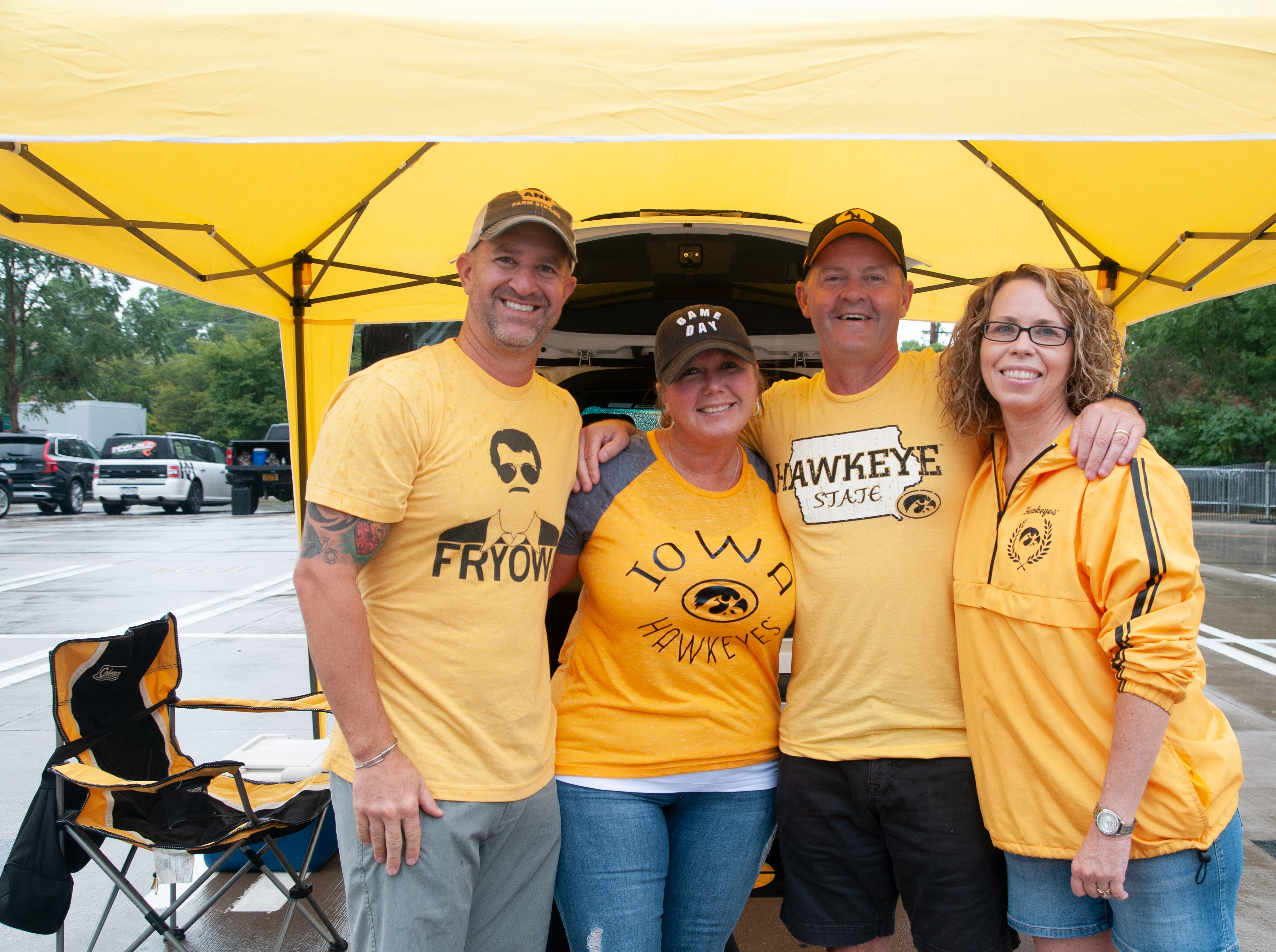 Sam, 51, and Lori Houston, 52, (left), and Mark, 49, and Jennifer Jacobson, 47, of Cedar Rapids, Saturday, Sept. 1, 2018, while tailgating before the Iowa game against Northern Illinois in Iowa City.