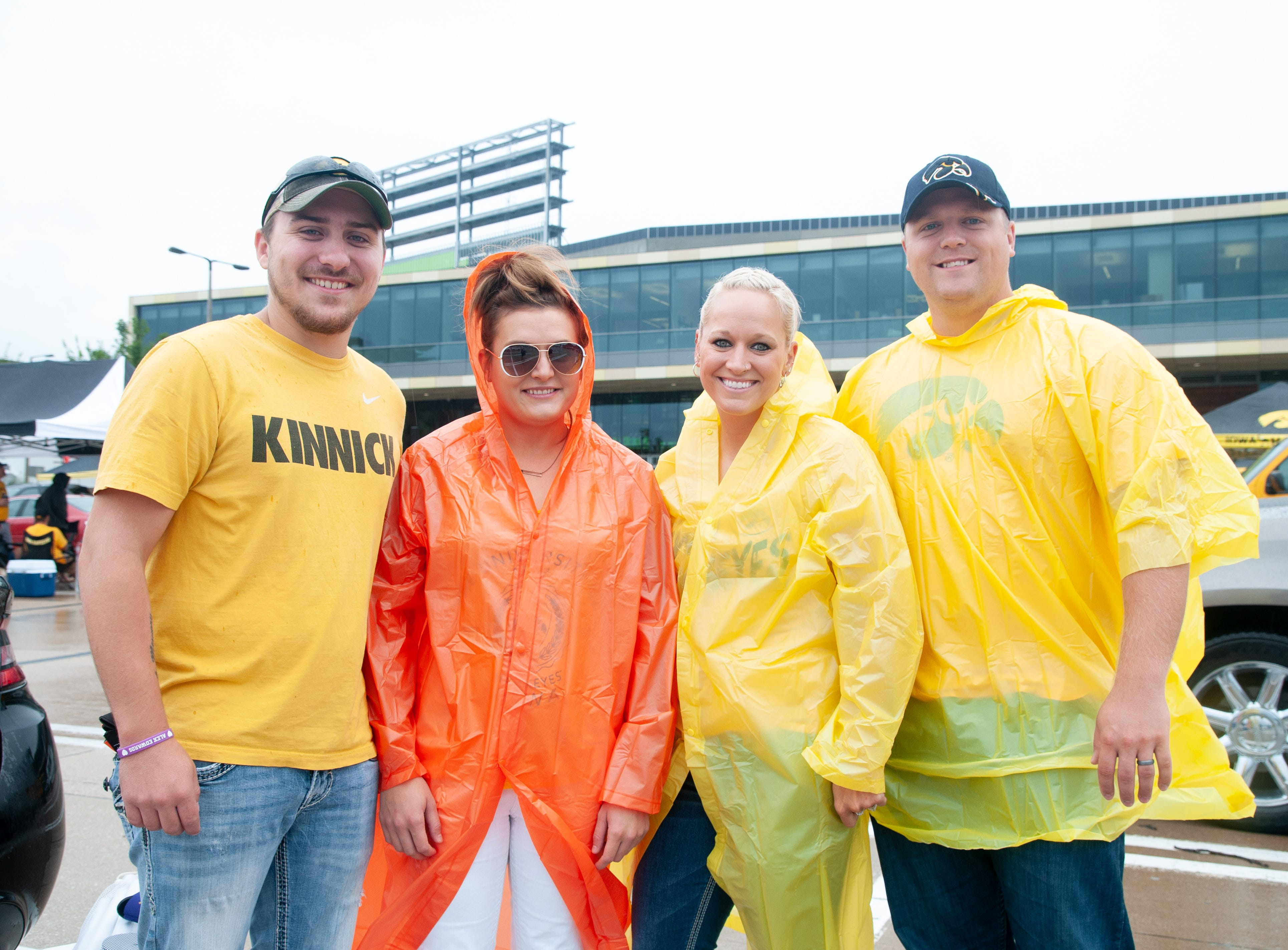 Derek Paetz, 23, (left), Alex Eagle, 24, Kalli Anson, 31, and Mike Anson, 30, of Muscatine, Saturday, Sept. 1, 2018, while tailgating before the Iowa game against Northern Illinois in Iowa City.