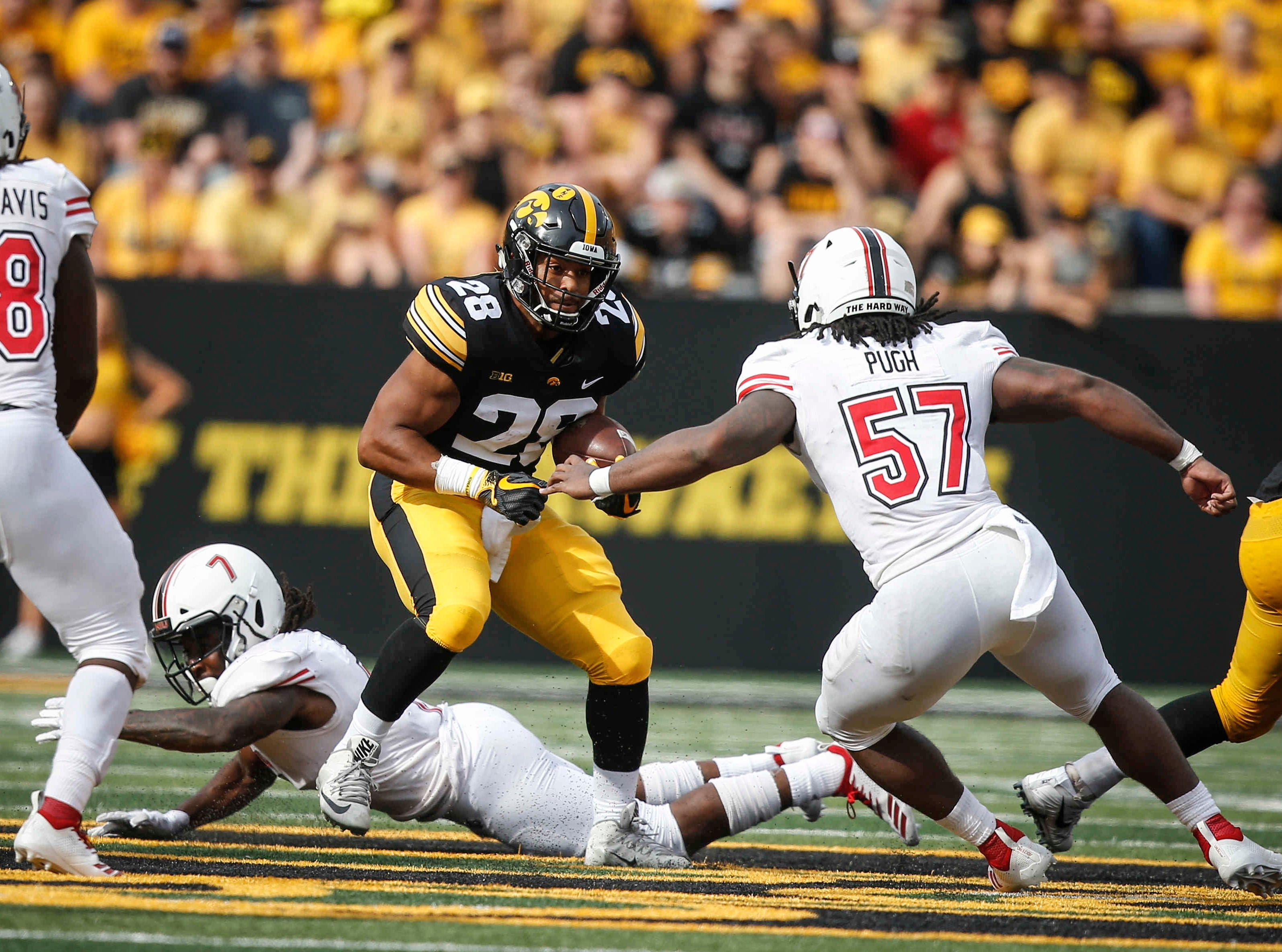 Iowa running back Toren Young carries the ball against Northern Illinois on Saturday, Sept. 1, 2018, at Kinnick Stadium in Iowa City.
