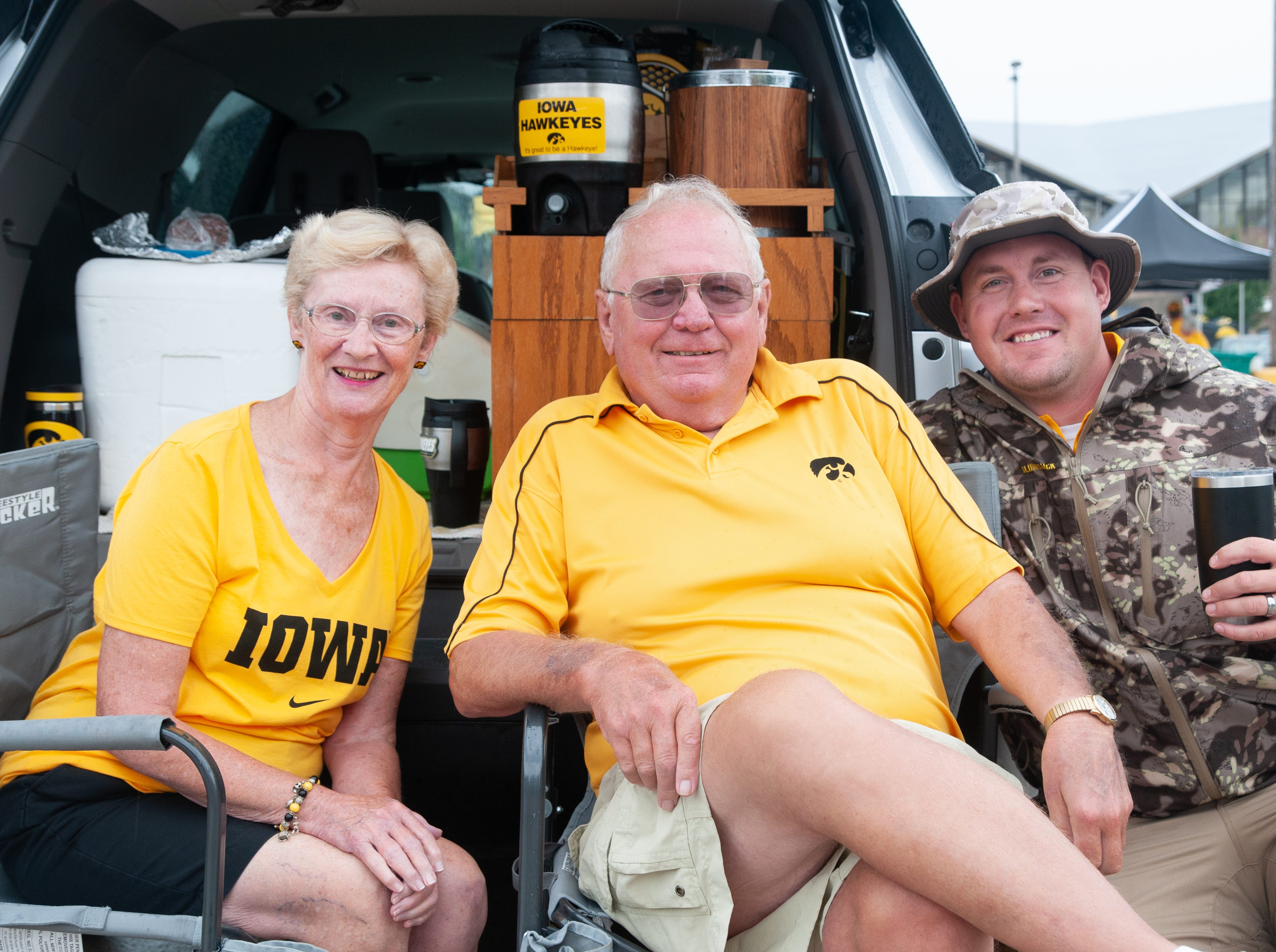 Donna and LeRoy Luepker, both 77, (left), and Jacob Koch, 31, of Mechanicsville and Lowden, Saturday, Sept. 1, 2018, while tailgating before the Iowa game against Northern Illinois in Iowa City.