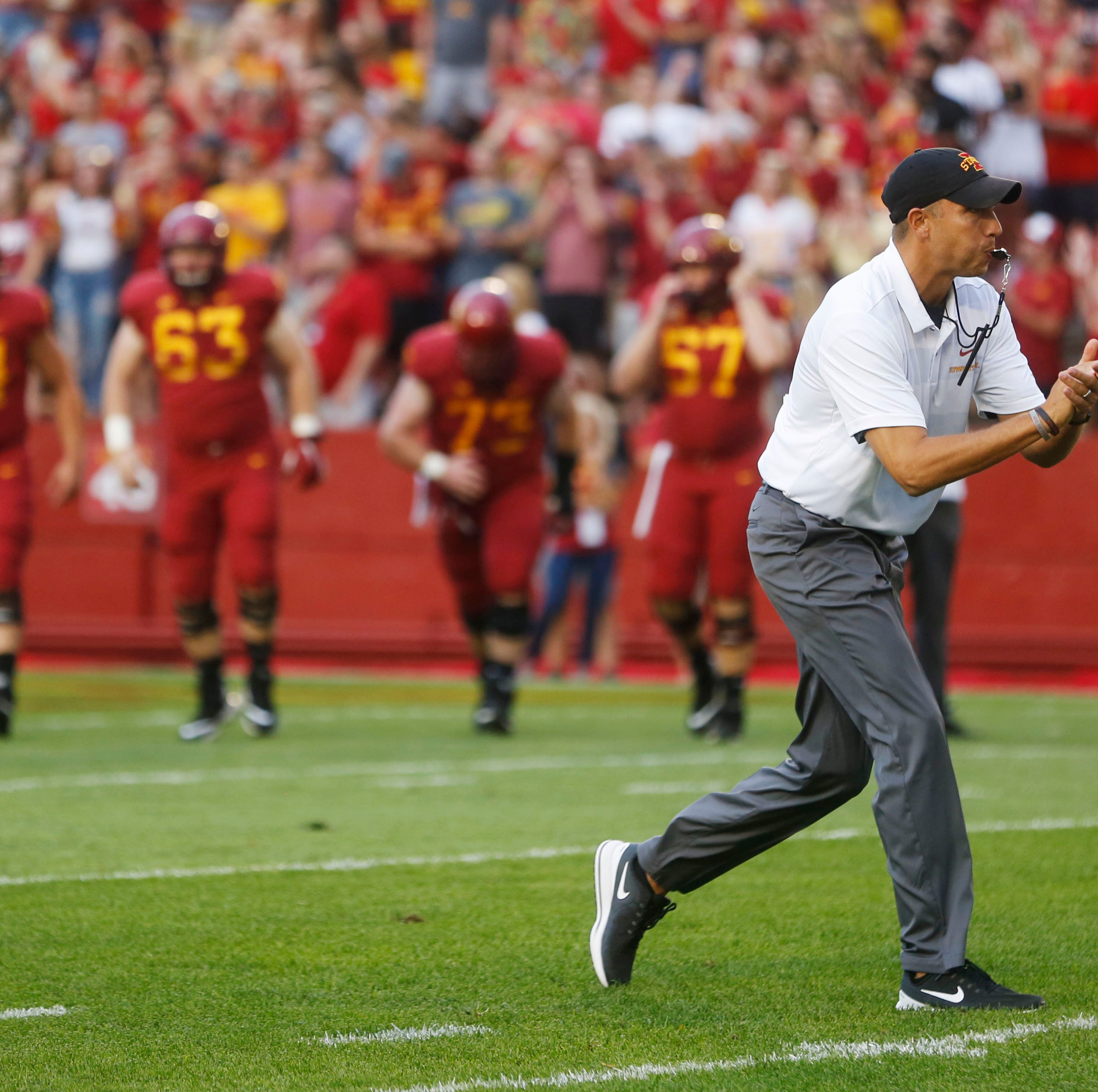 Iowa State head coach Matt Campbell  directs his...