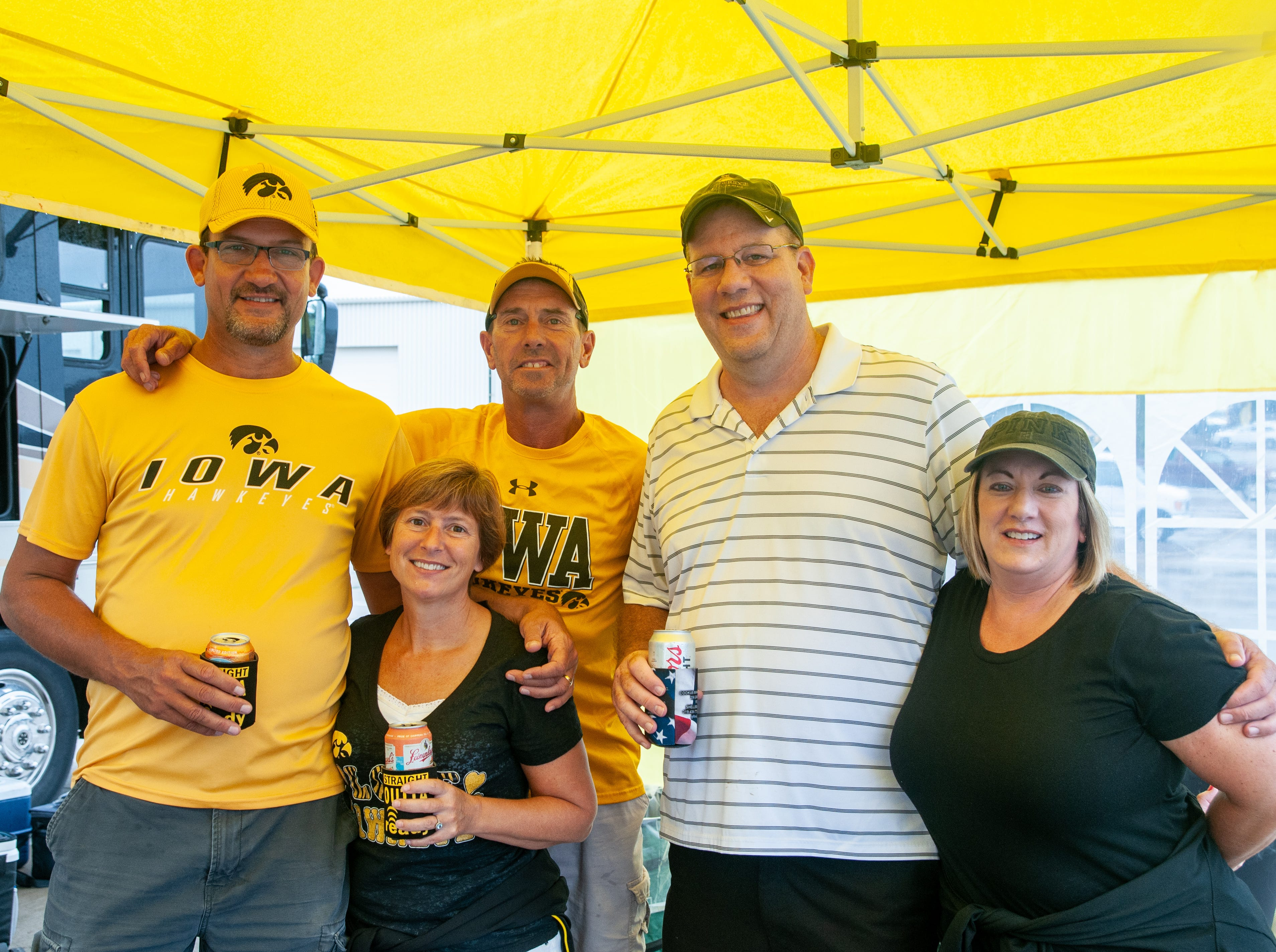 Tony, 49, and Kris Michels, 51, (left), Bryan Reynolds, 49, and Jeremy, 52, and Cynthia Lundy, 47, Saturday, Sept. 1, 2018, while tailgating before the Iowa game against Northern Illinois in Iowa City.