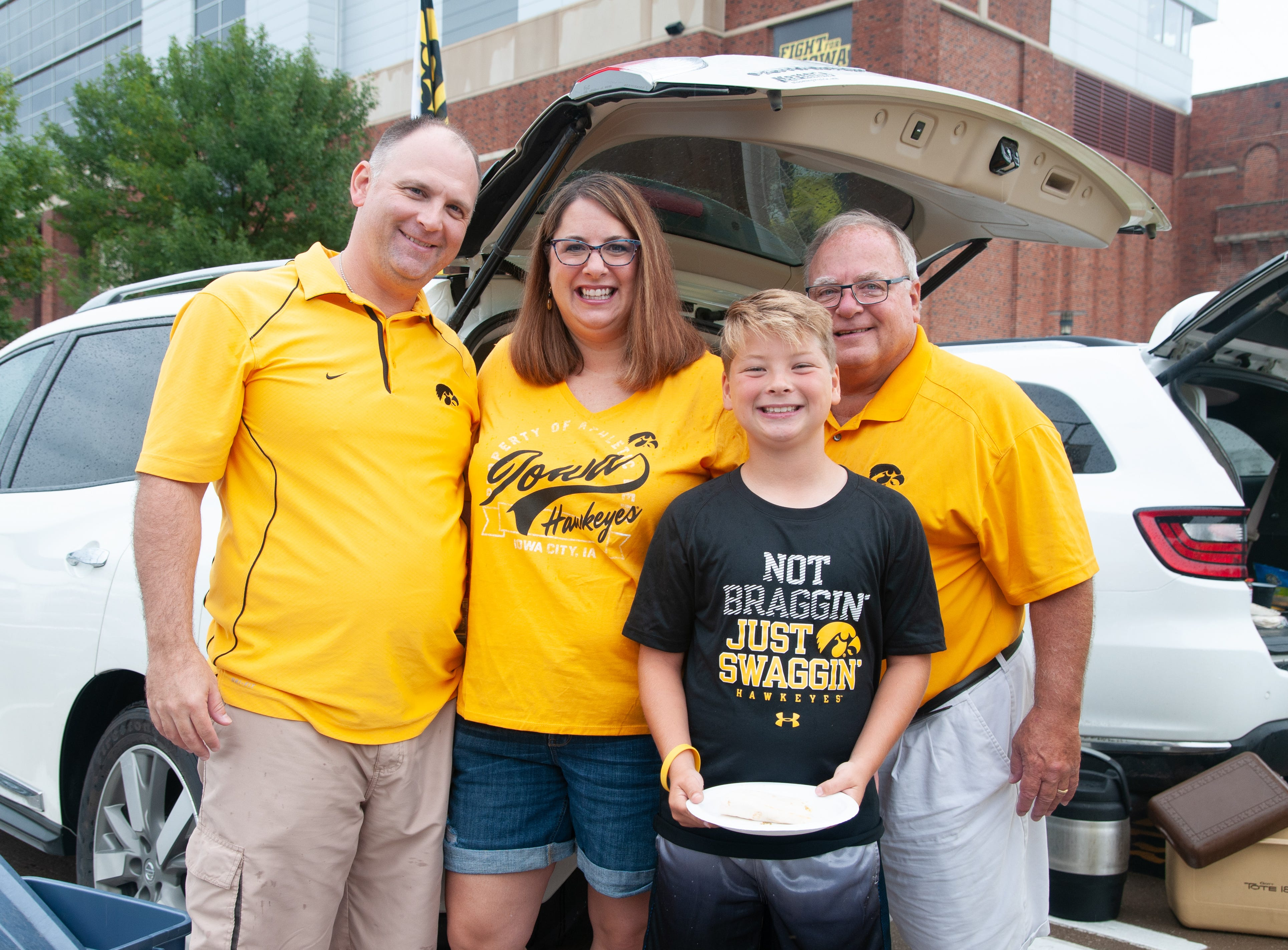 The O'Connor family, (left), and Darrel Burns, 66, of Sheldon and North Liberty, Saturday, Sept. 1, 2018, while tailgating before the Iowa game against Northern Illinois in Iowa City.