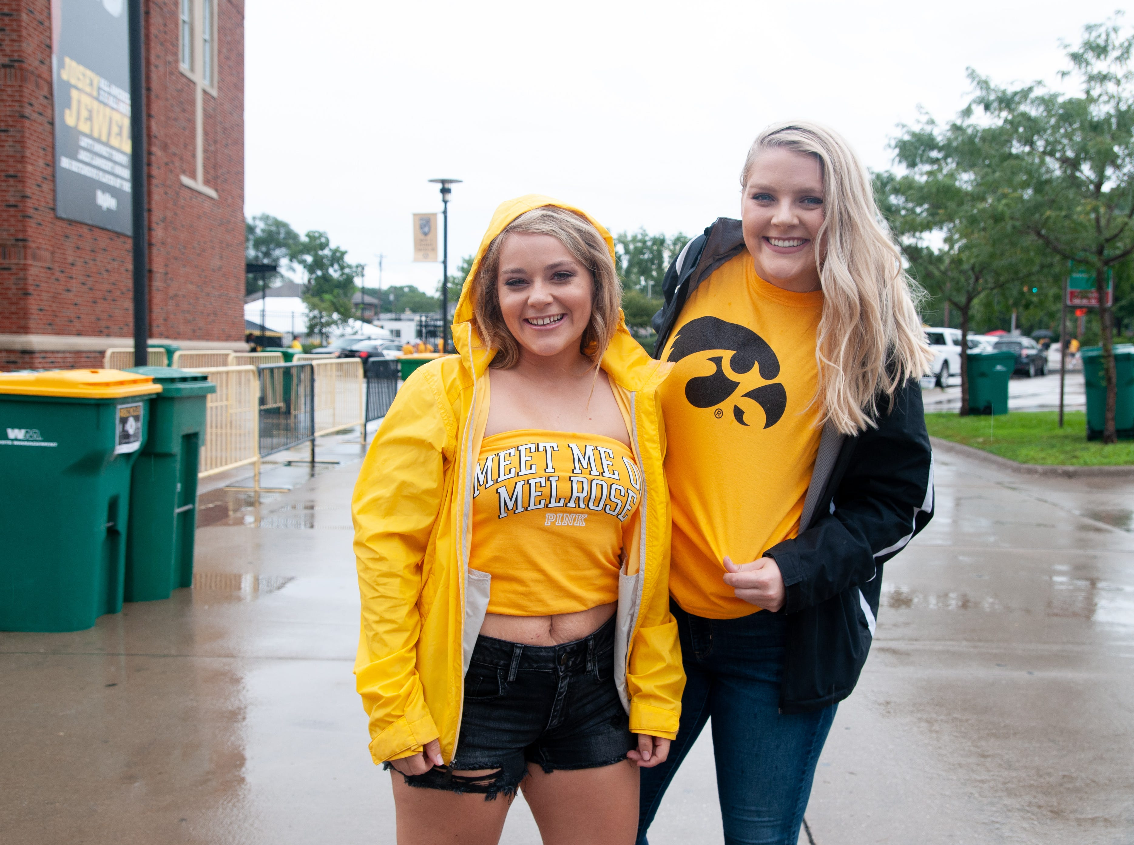 Jayme Brownlee, 22, (left), and Paige Davidson, 22, of Ottumwa, Saturday, Sept. 1, 2018, while tailgating before the Iowa game against Northern Illinois in Iowa City.