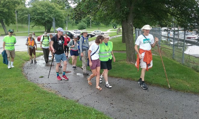 A group of marchers led by Bold Iowa's Ed Fallon departs from Birdland Park. The group will make an eight-day trek to Fort Dodge to raise awareness and show unity against the Dakota Access Pipeline.