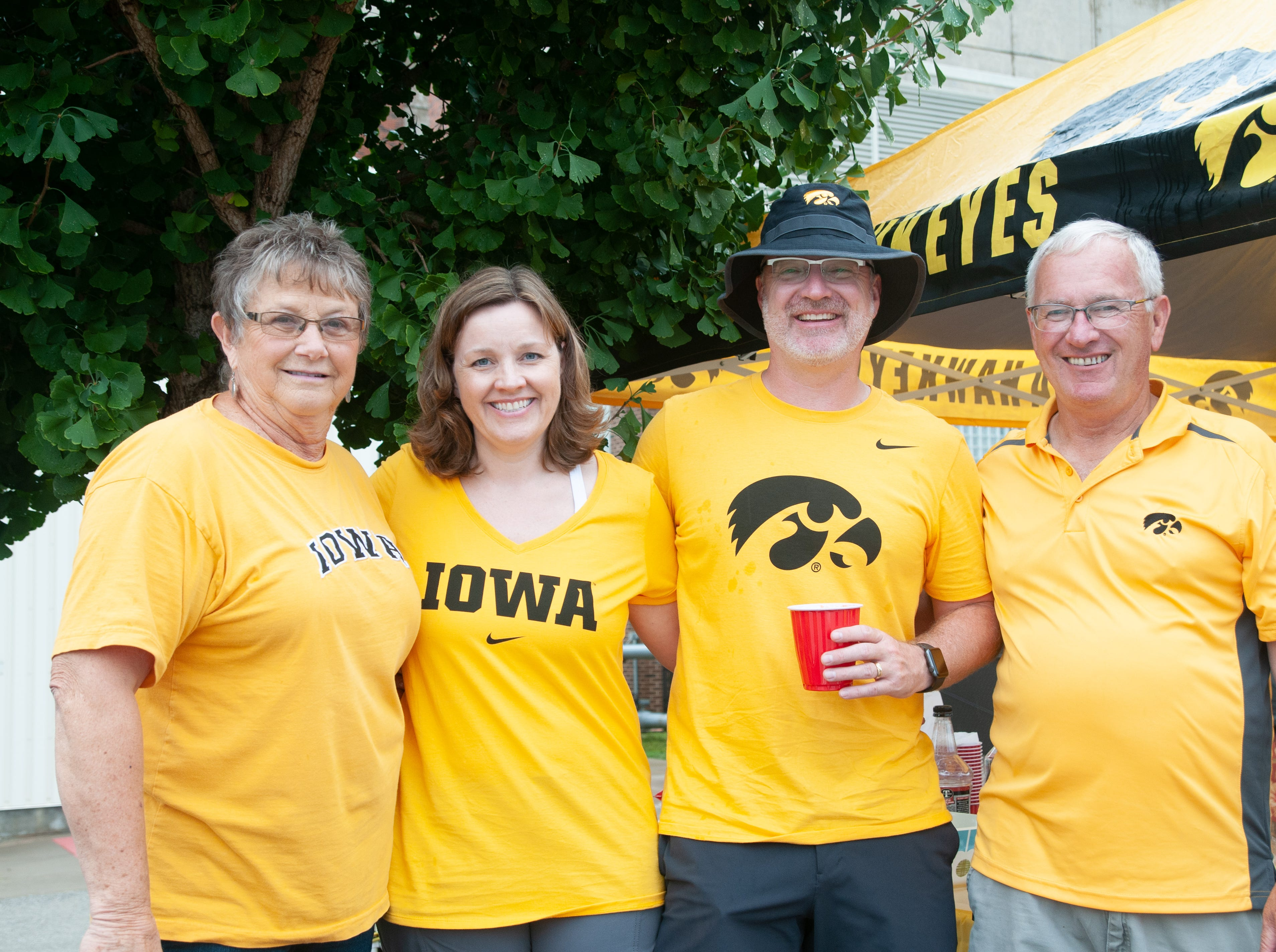 Judy, 76, (left), Nikki, 47, Curt, 48, and Mike Strait, 65, of Washington and Minneapolis, Saturday, Sept. 1, 2018, while tailgating before the Iowa game against Northern Illinois in Iowa City.