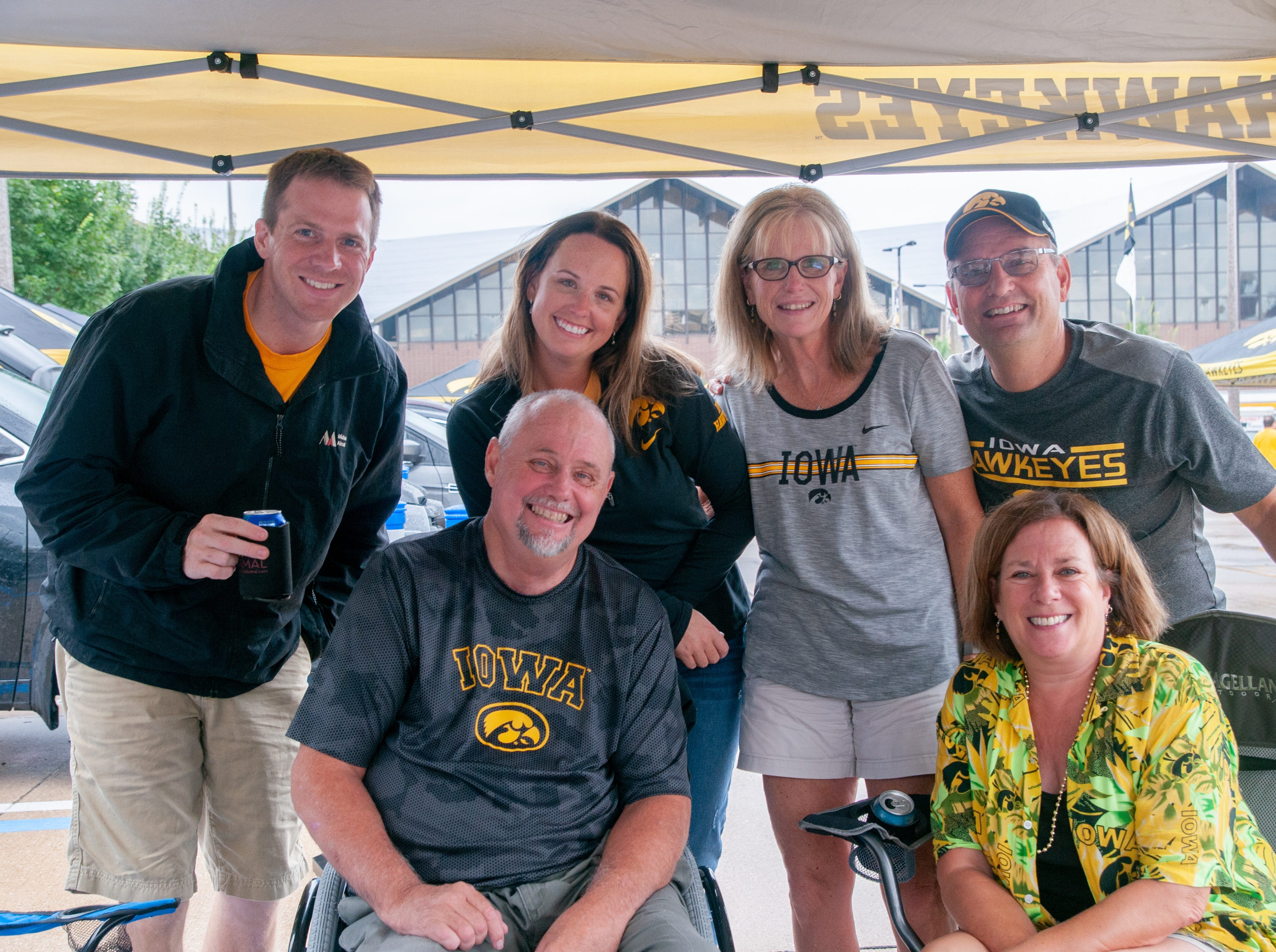 The Jansens, DeGoegy and Valbrachg families, of Ankeny, Baxter, and Marshalltown, Saturday, Sept. 1, 2018, while tailgating before the Iowa game against Northern Illinois in Iowa City.