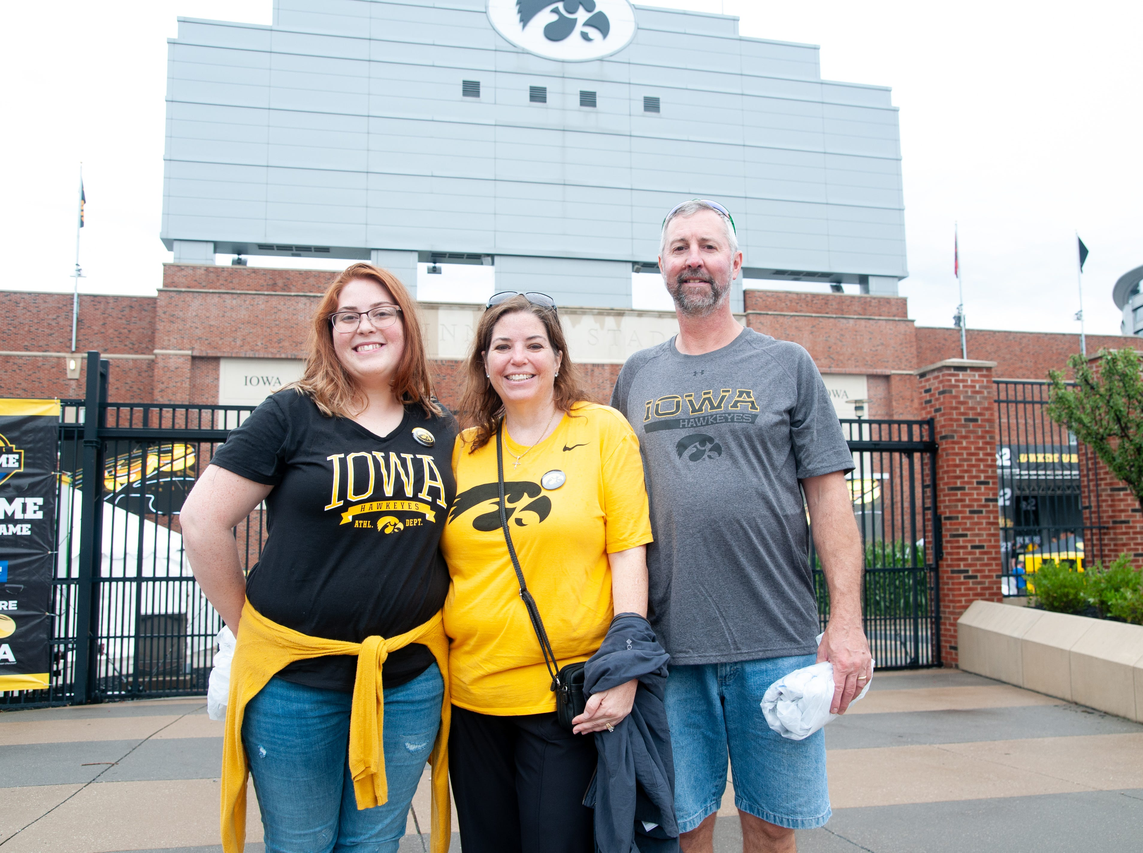 Stephanie Weinberger, 23, (left), and Cheryl, 50, and John Lehman, 55, of DeKalb, Saturday, Sept. 1, 2018, while tailgating before the Iowa game against Northern Illinois in Iowa City.