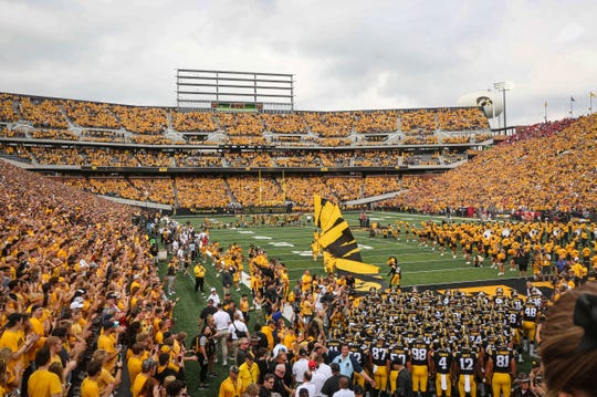 The Iowa Hawkeyes football team takes the field for the opening game of the 2018 season prior to kickoff against Northern Illinois on Saturday, Sept. 1, 2018, at Kinnick Stadium in Iowa City.