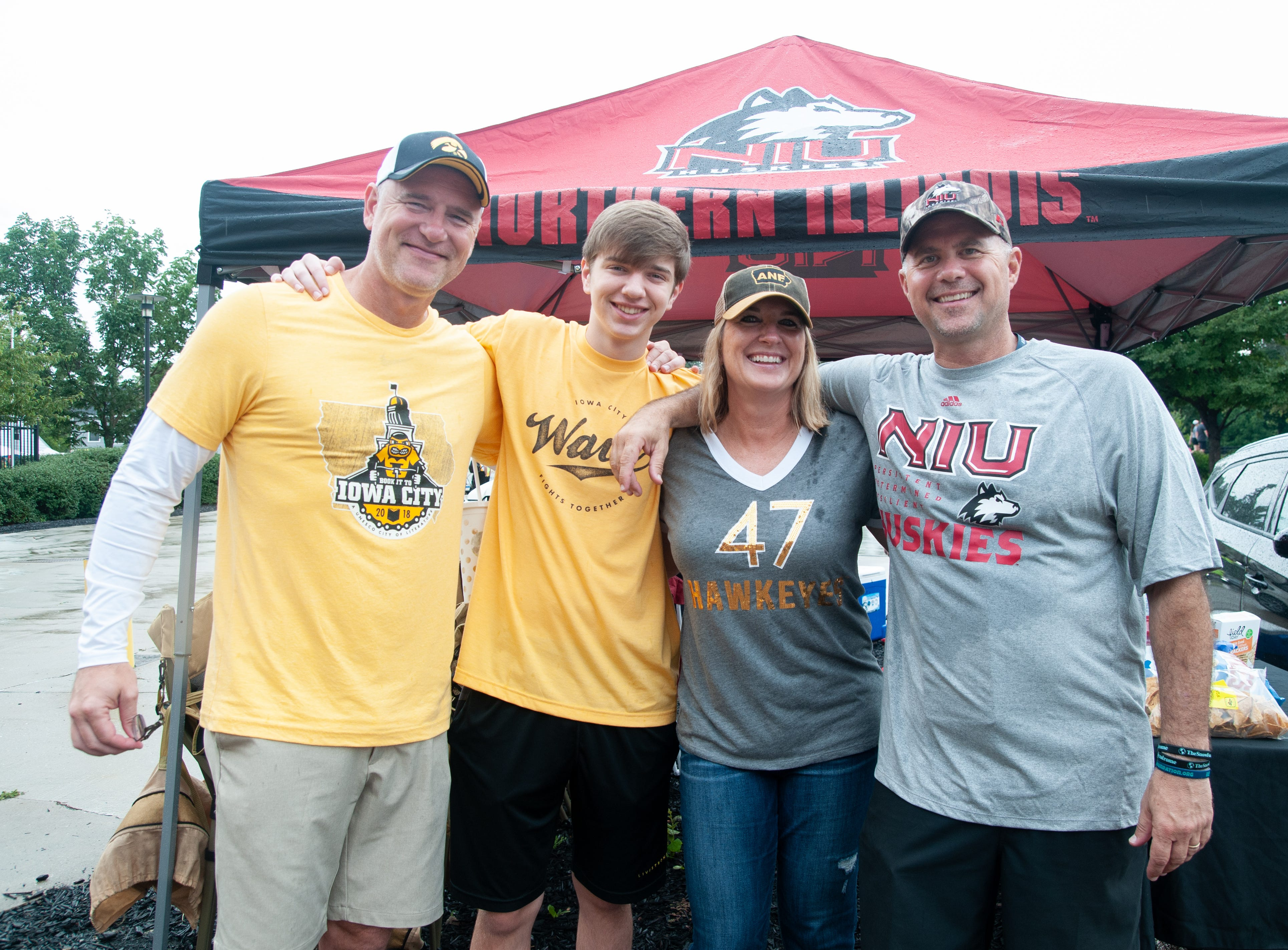 Chuck, 49, Aidan, 14, and Shelly Vaughn, 49, (left), and Matt Ference, 51, of Des Moines and Johnston, Saturday, Sept. 1, 2018, while tailgating before the Iowa game against Northern Illinois in Iowa City.
