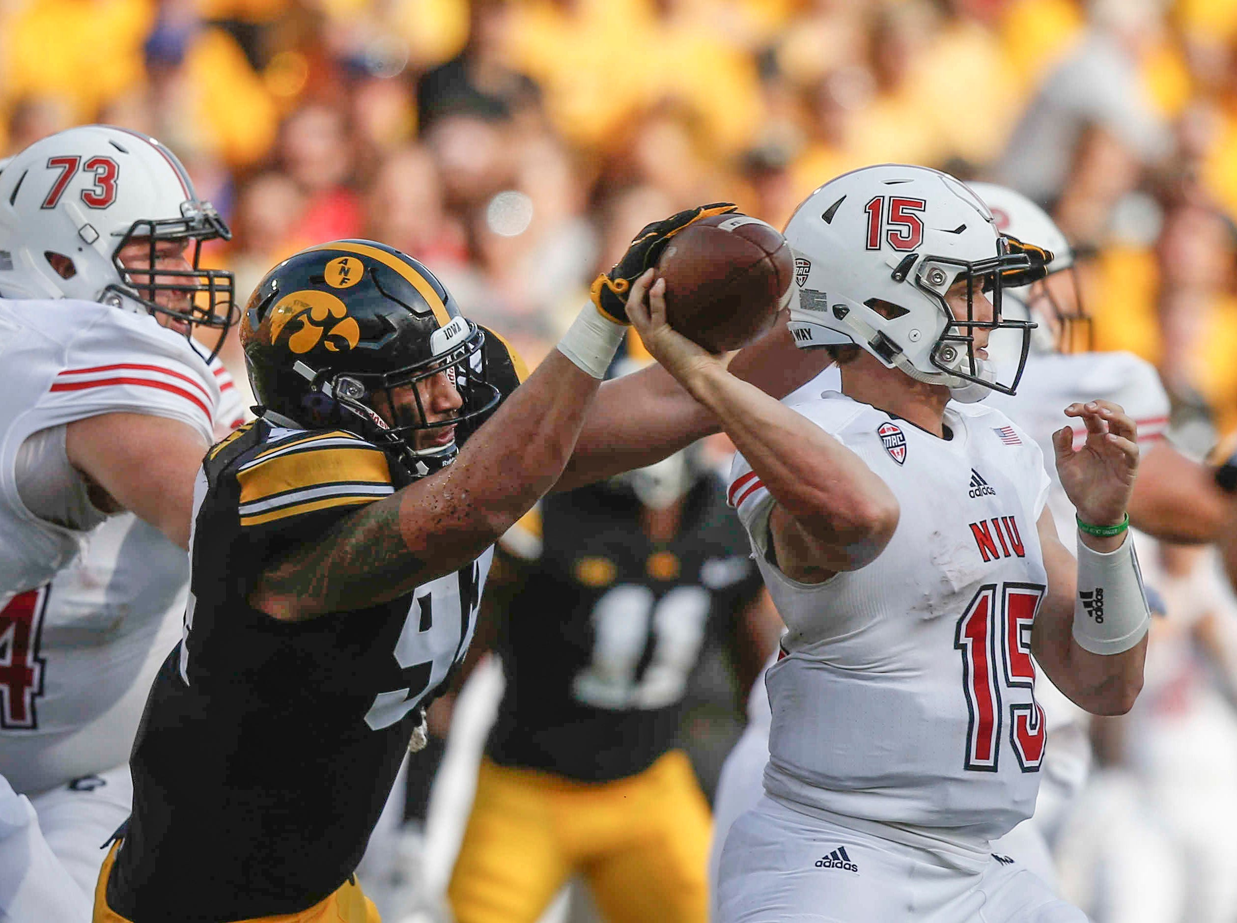 Iowa defensive end A.J. Epenesa gets his hand on the ball as Northern Illinois quarterback Marcus Childers throws a pass on Saturday, Sept. 1, 2018, at Kinnick Stadium in Iowa City.