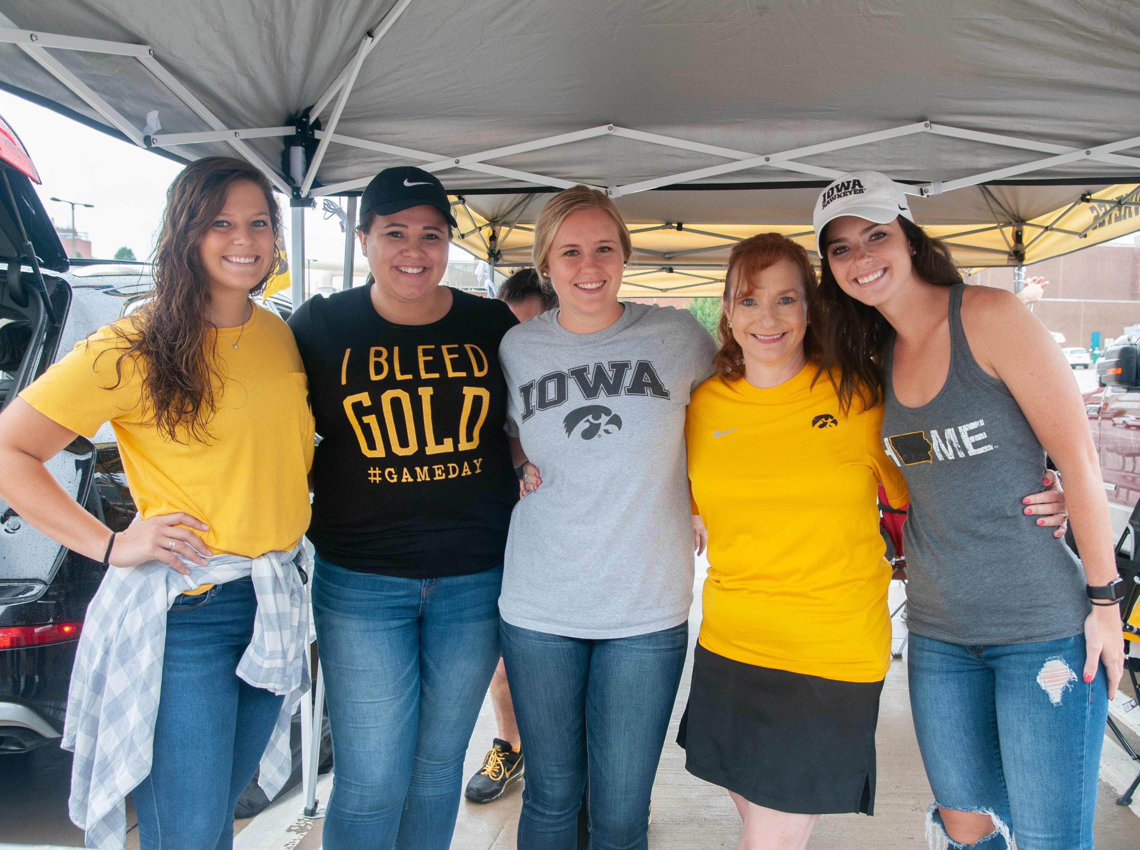 Kathryn Matson, 24, Jasmine Binion, 24, Meredith Bailey, 22, Trish Matson, 45, and Liz Finerty, 24, of the Quad Cities, Saturday, Sept. 1, 2018, while tailgating before the Iowa game against Northern Illinois in Iowa City.