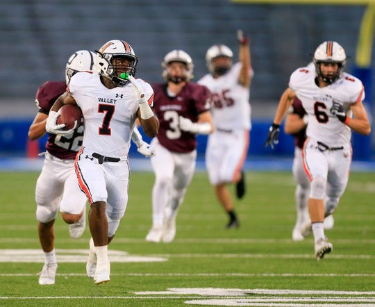 Valley's Tre Fugate runs for a touchdown during the Dowling West Des Moines Valley game at Drake stadium Aug. 31, 2018.