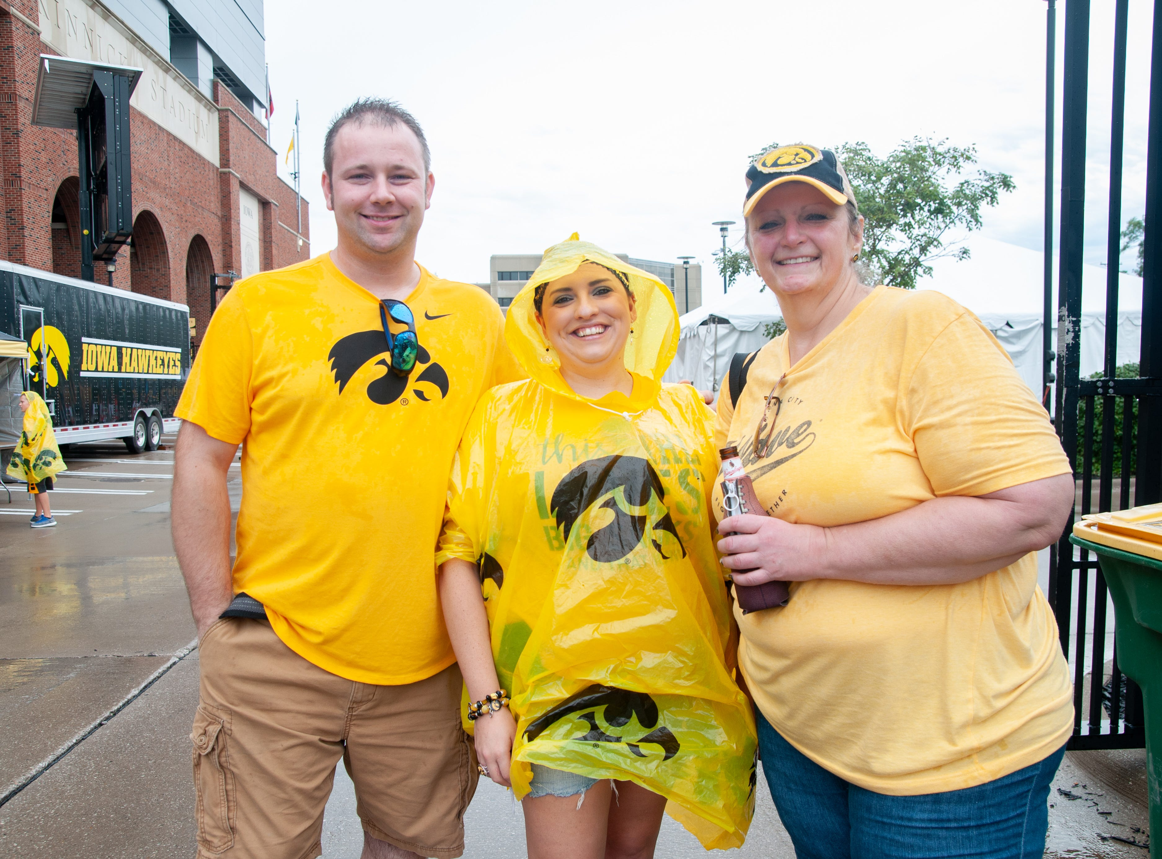 Andy Pettyjohn, 34, (left), Alicia Schoolcraft, 32, and Vicki Ballou, 50, of Pella, Centerville and Keota, Saturday, Sept. 1, 2018, while tailgating before the Iowa game against Northern Illinois in Iowa City.