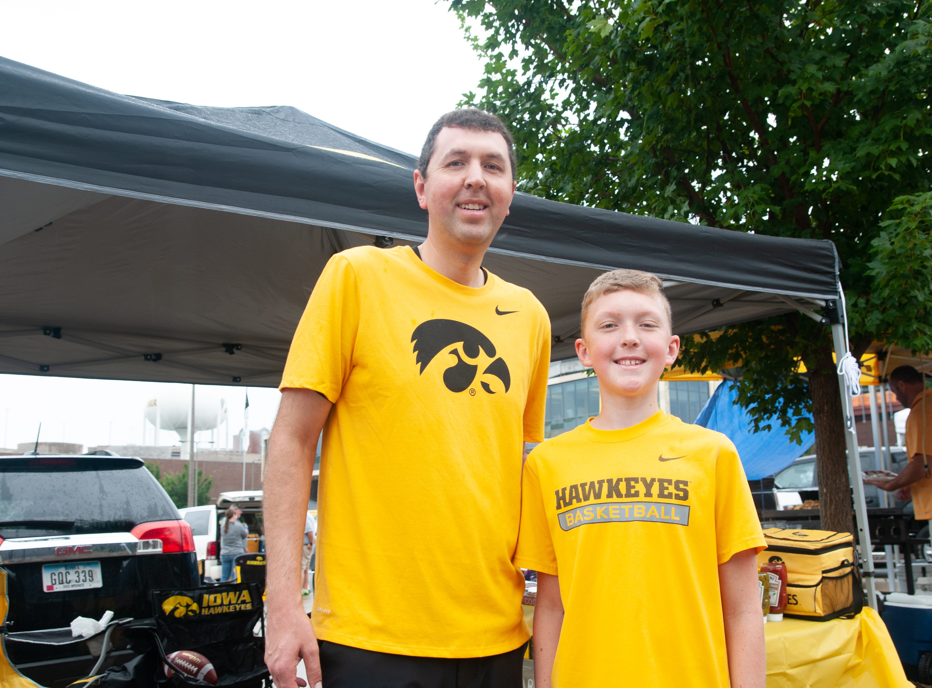 Steve, 40, (left), and Kyle Etka, 14 of Burlington, Saturday, Sept. 1, 2018, while tailgating before the Iowa game against Northern Illinois in Iowa City.