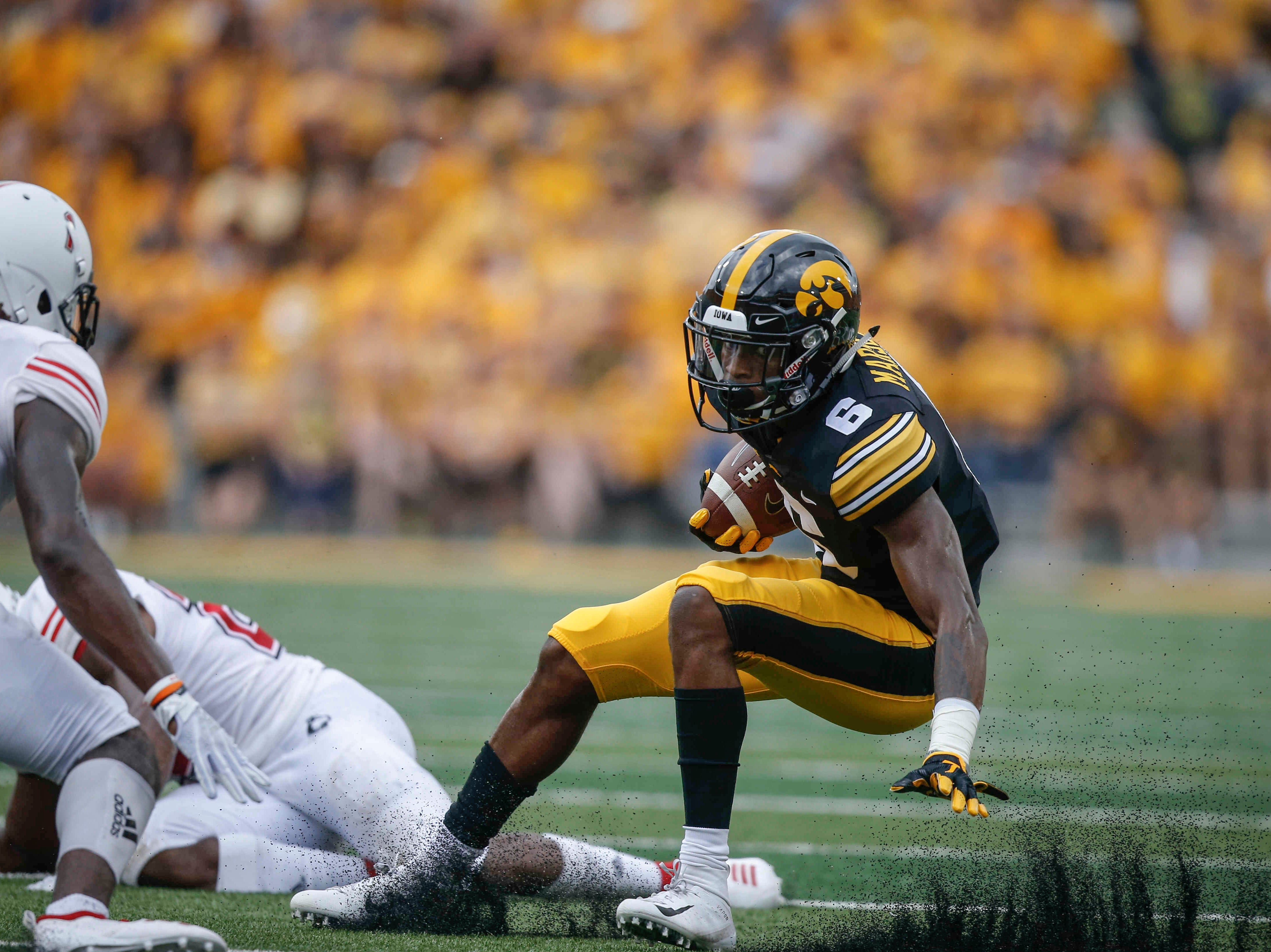 Iowa wide receiver Ihmir Smith-Marsette runs the ball in the first quarter against Northern Illinois on Saturday, Sept. 1, 2018, at Kinnick Stadium in Iowa City.