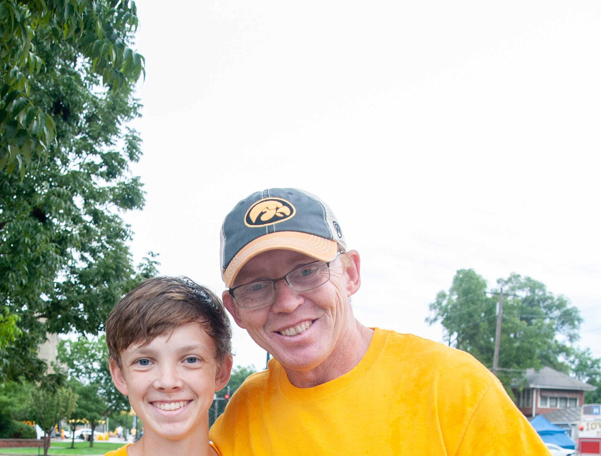 Joey, 14, (left), and John Ward, 52, of Springville, Saturday, Sept. 1, 2018, while tailgating before the Iowa game against Northern Illinois in Iowa City.