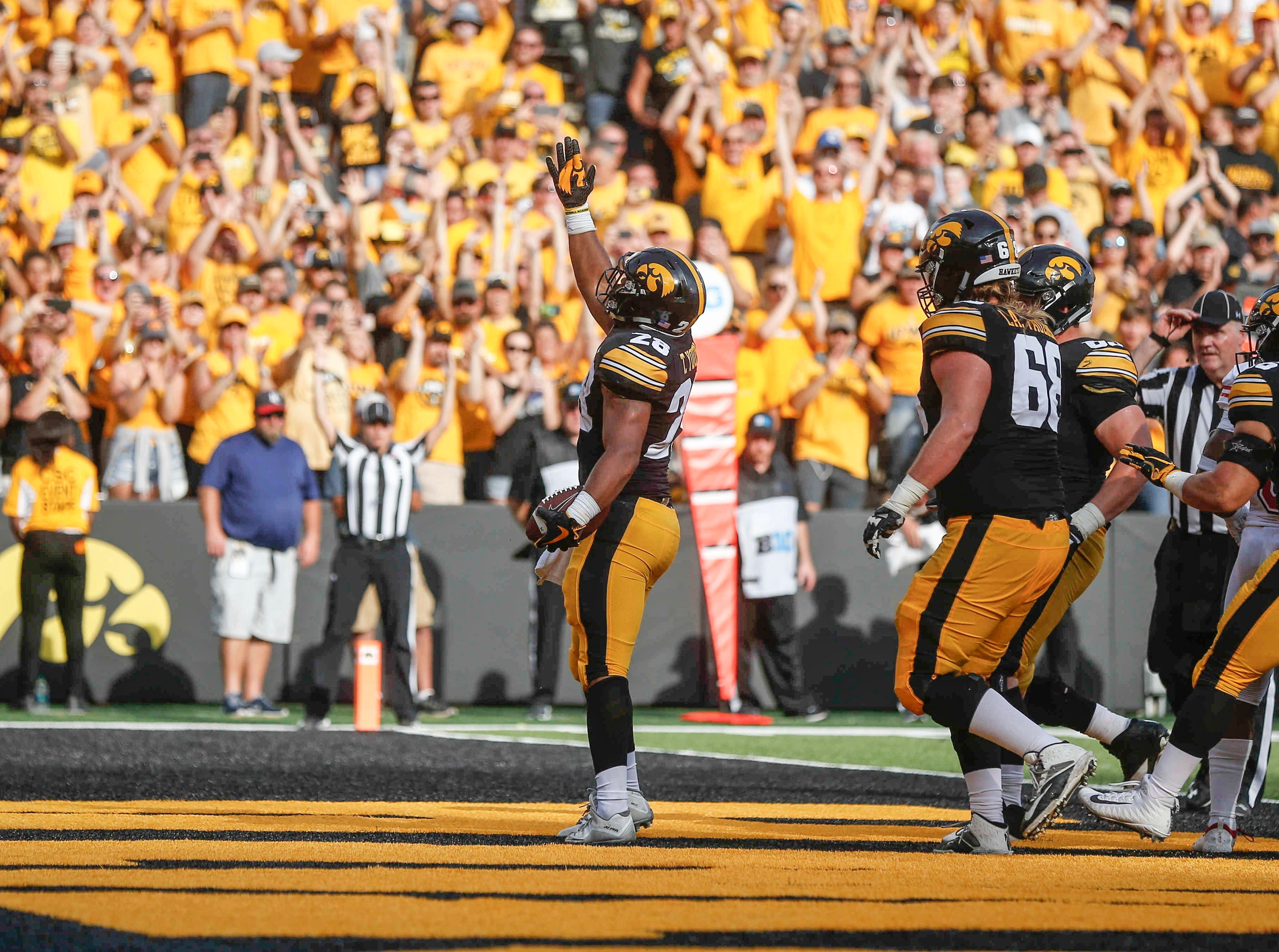 Iowa sophomore Toren Young celebrates after scoring a touchdown against Northern Illinois on Saturday, Sept. 1, 2018, at Kinnick Stadium in Iowa City.