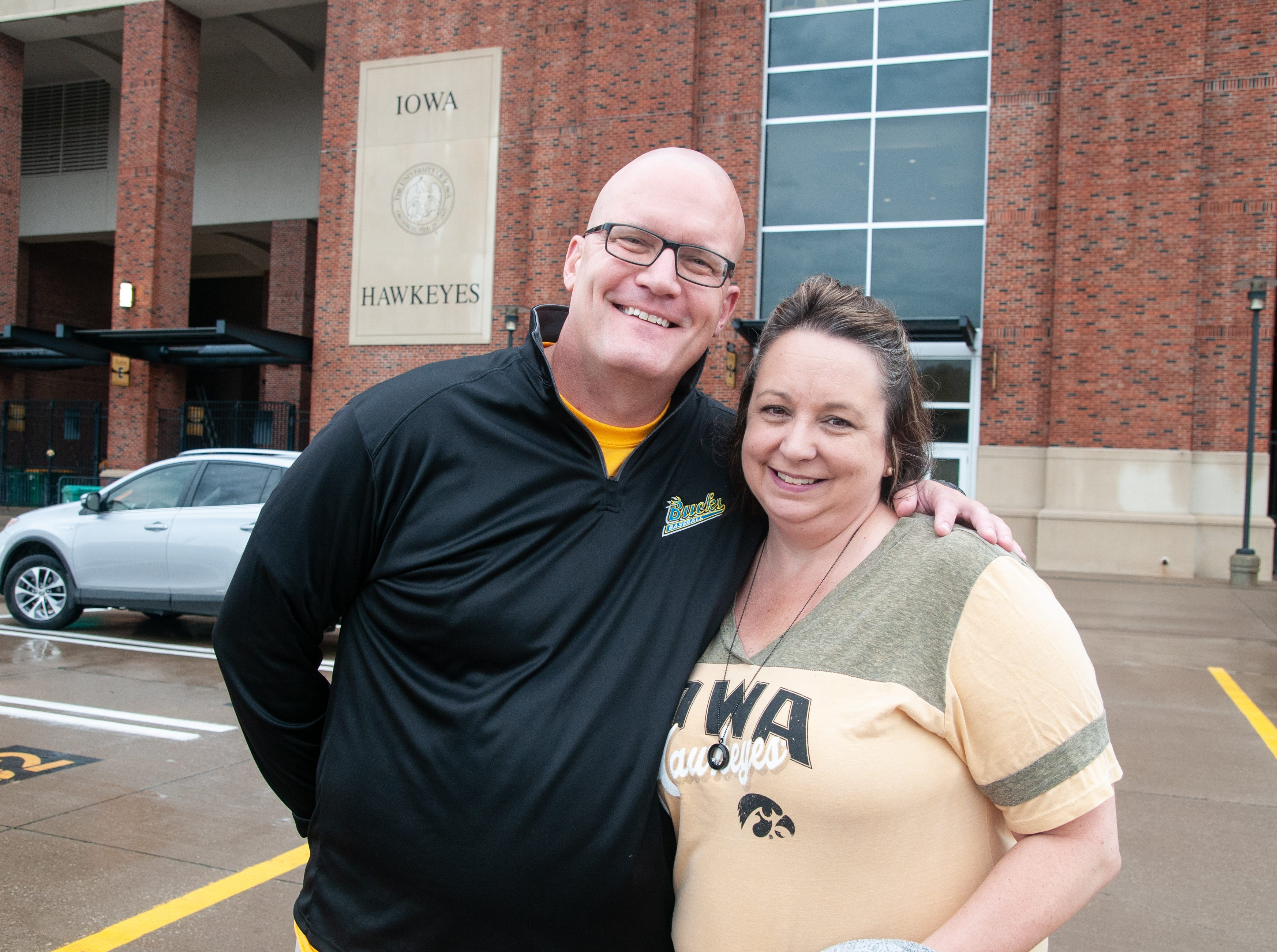 Chad Hammar, 46, (left), and Angie Tracy, 49, of Fort Dodge, Saturday, Sept. 1, 2018, while tailgating before the Iowa game against Northern Illinois in Iowa City.